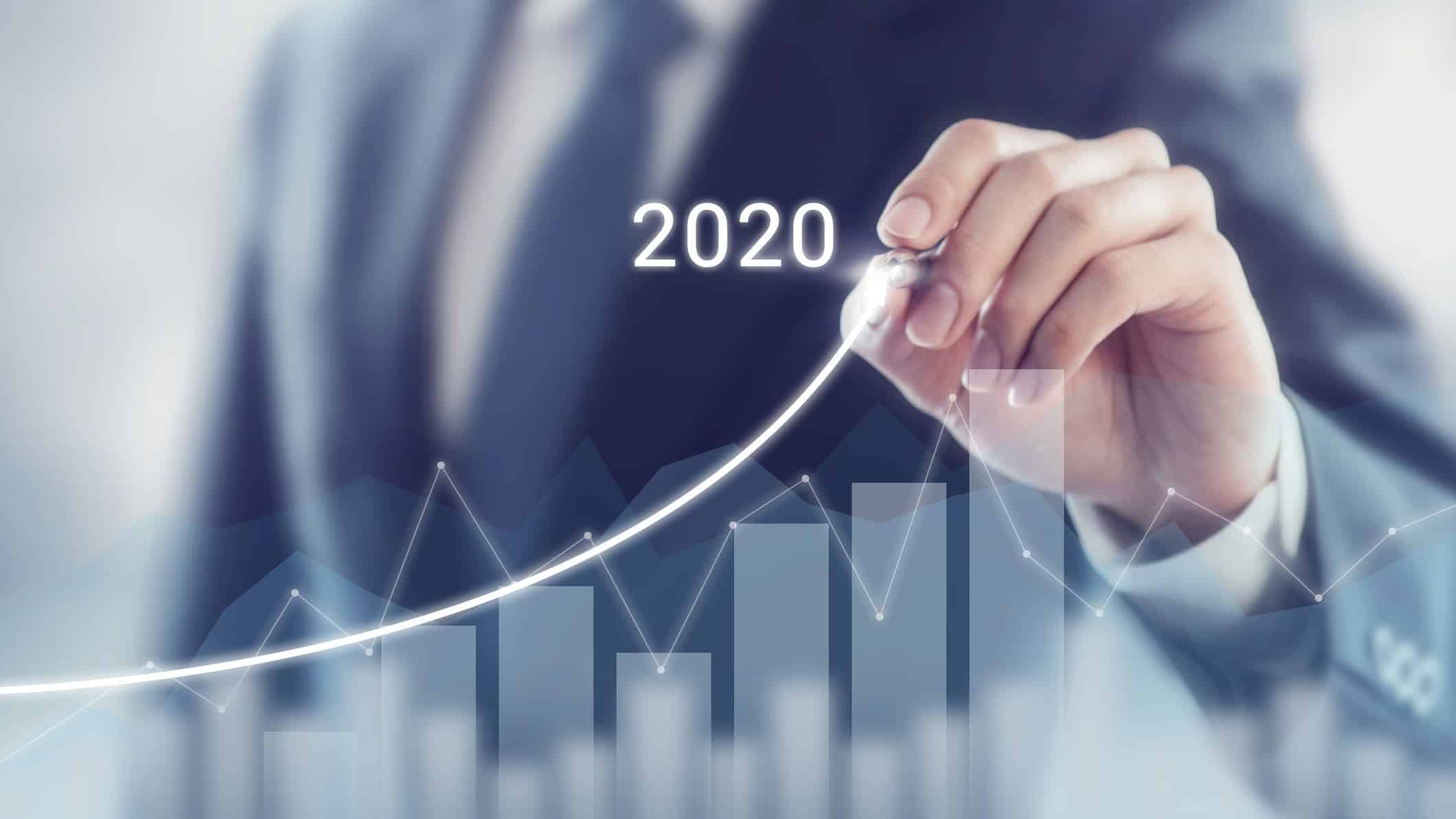 man drawing upward curve on 2020 graph, asx share price growth
