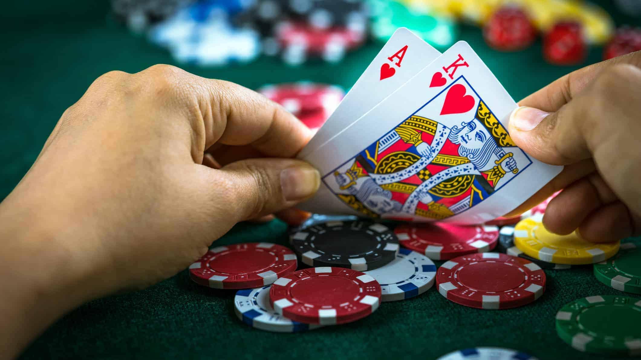 Casino Chips Winning Hand representing crown share price