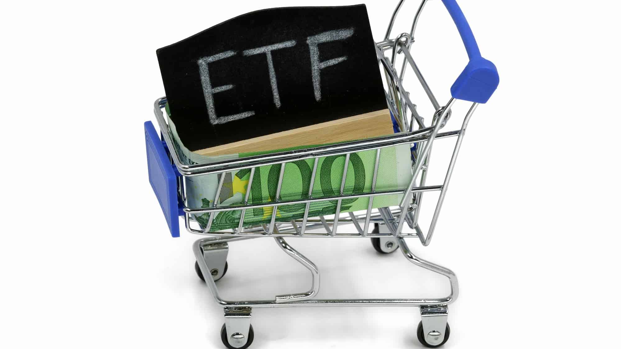 miniature shopping trolley containing black board with the word ETFs on it