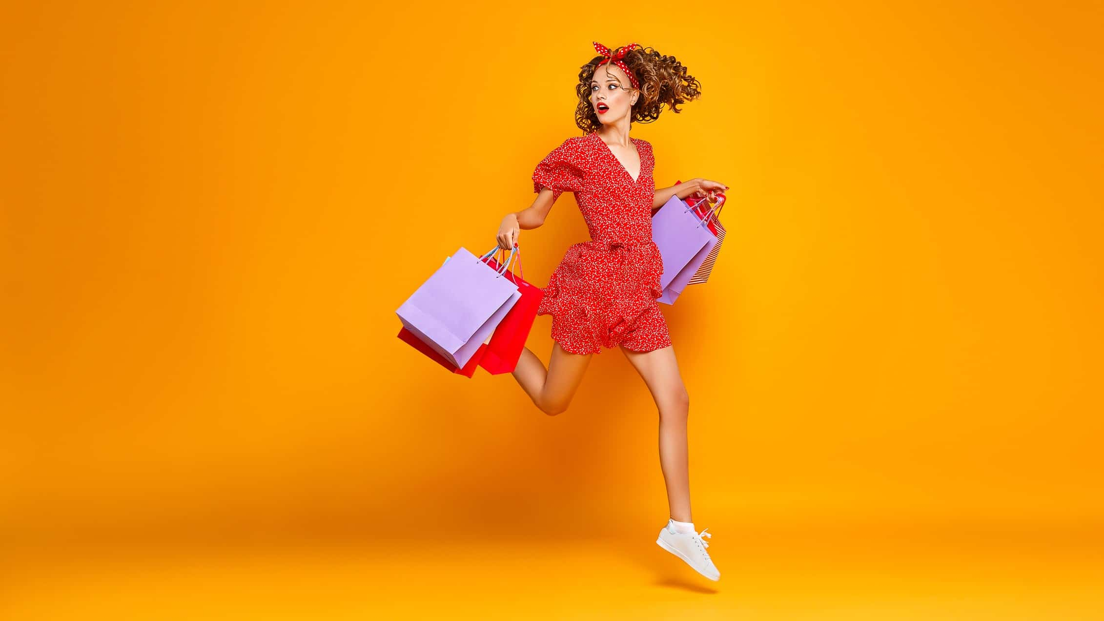 asx retail shares represented by woman excitedly holding shopping bags