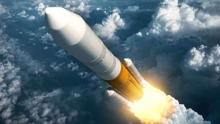 Rocket soaring through sky