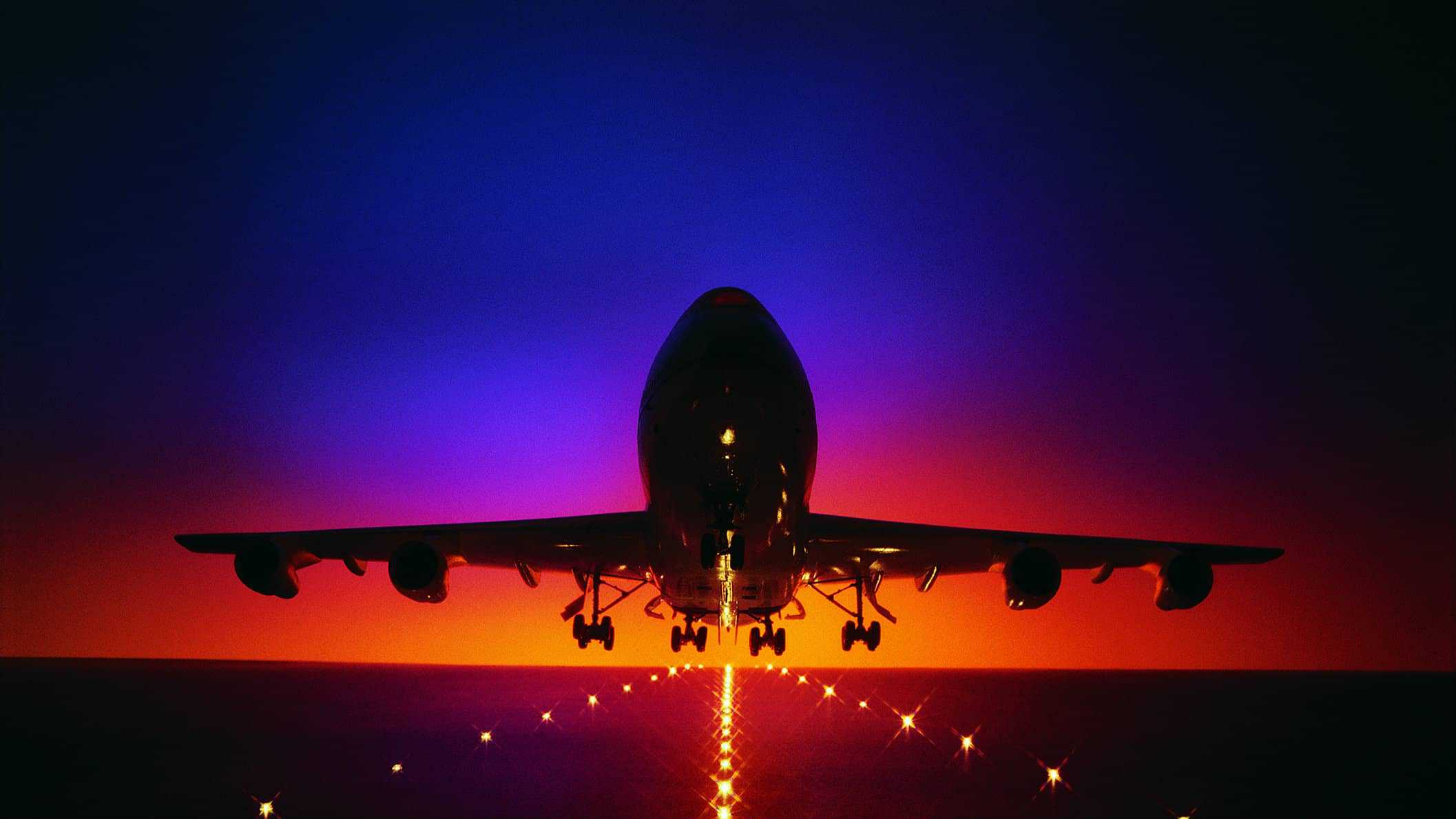 a plane takes off, climbing up into the sky, indicating positive lift in airline share price