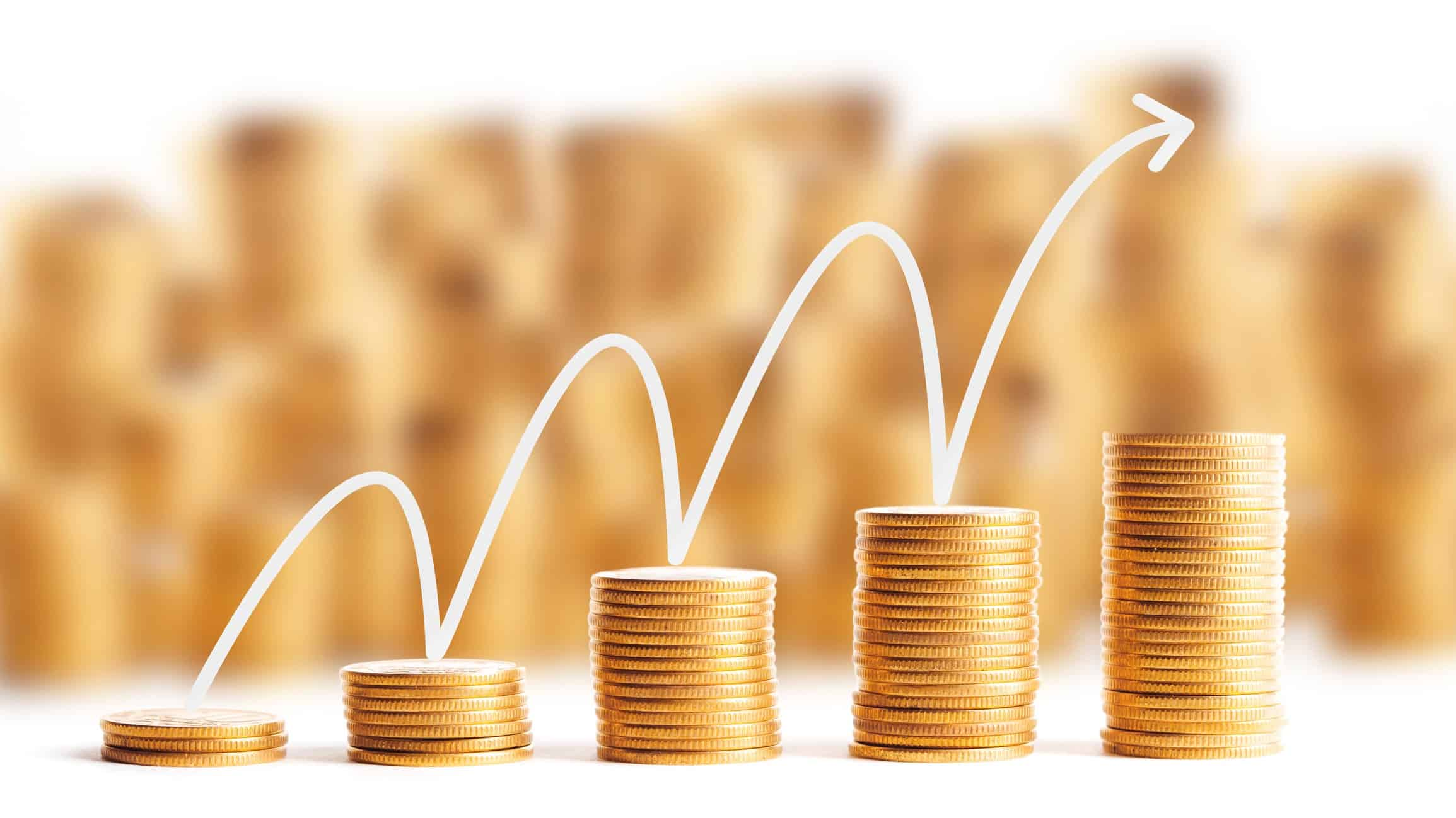 asx share price higher represented by stacks of gold coins growing higher