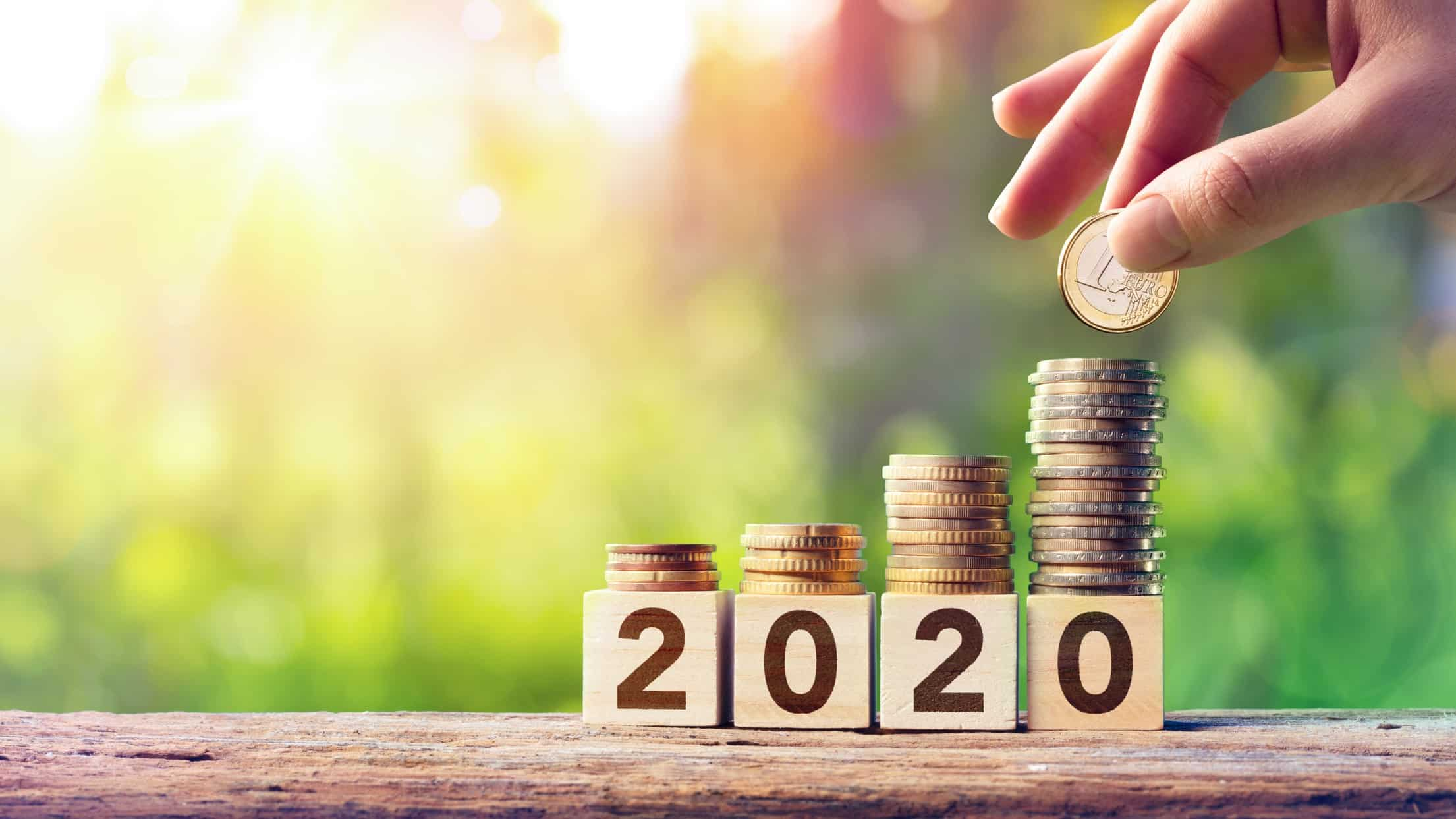 Growing stack of coins on top of wooden blocks spelling out '2020', future wealth, asx future