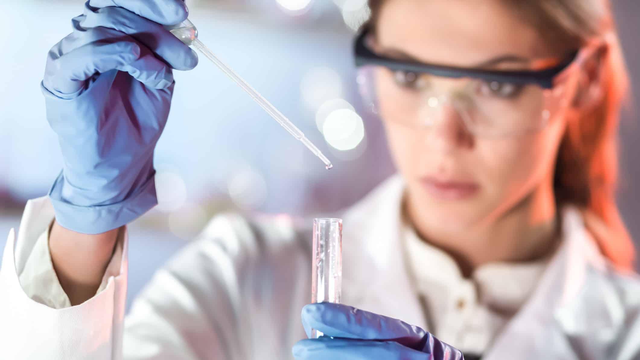 woman in lab coat conducting testing representing mesoblast share price