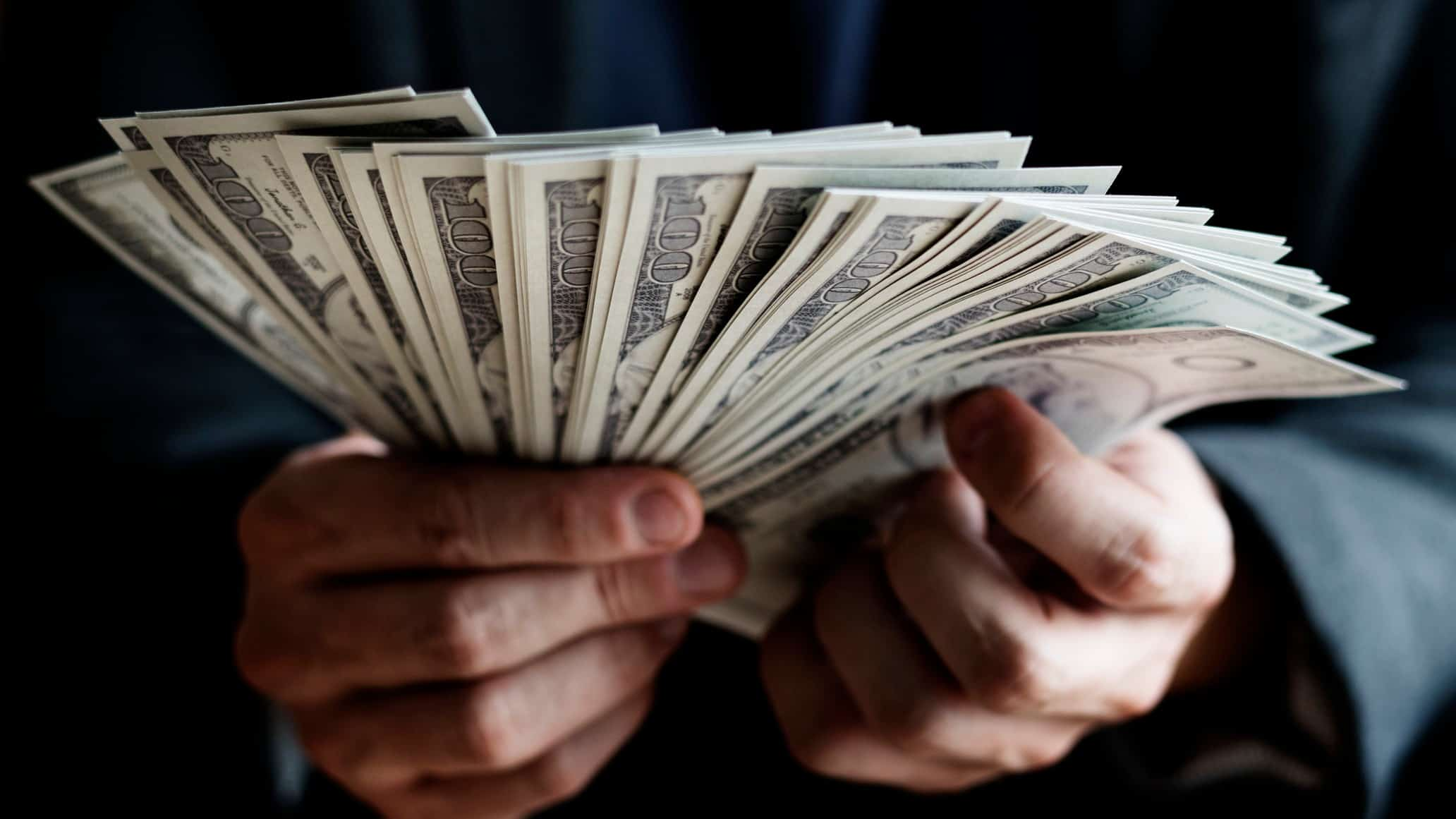Close up of hands holding US bank notes