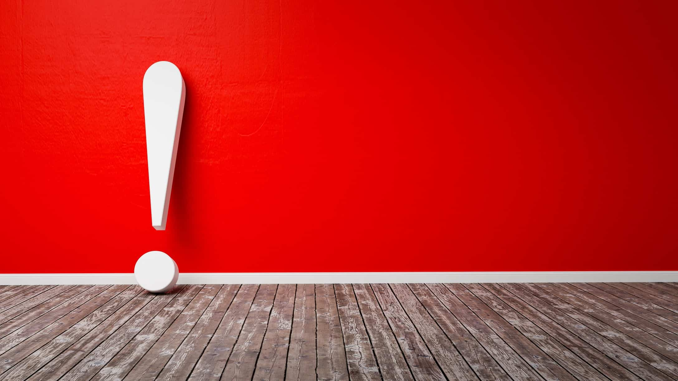 Red wall with large white exclamation mark leaning against it
