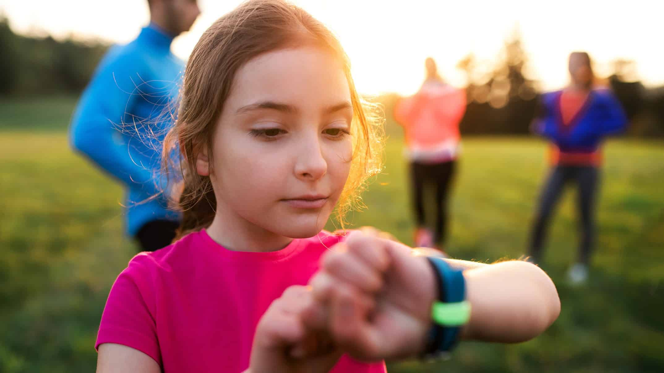 ASX wireless tech share represented by child looking at smart watch on her wrist