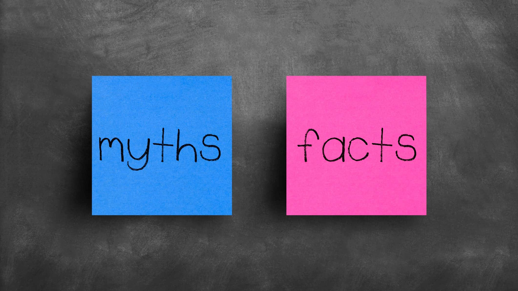 Blue post-it note with 'myths' written on it next to pink post-it note with 'facts' written on it