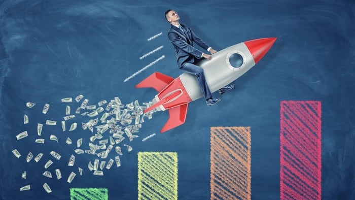 Investor riding a rocket blasting off over a share price chart