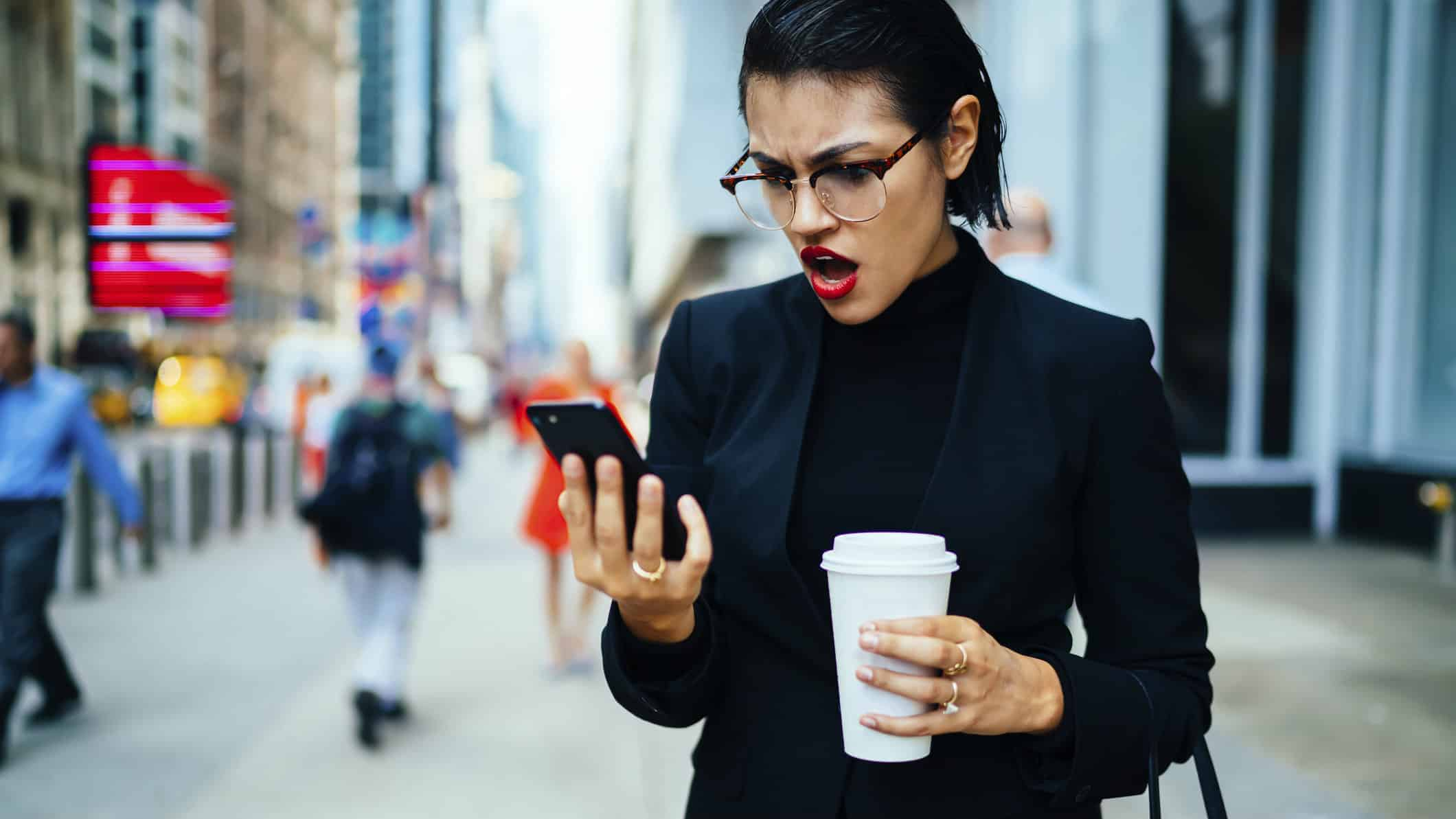 Falling ASX share price represented by shocked Investor looking at phone