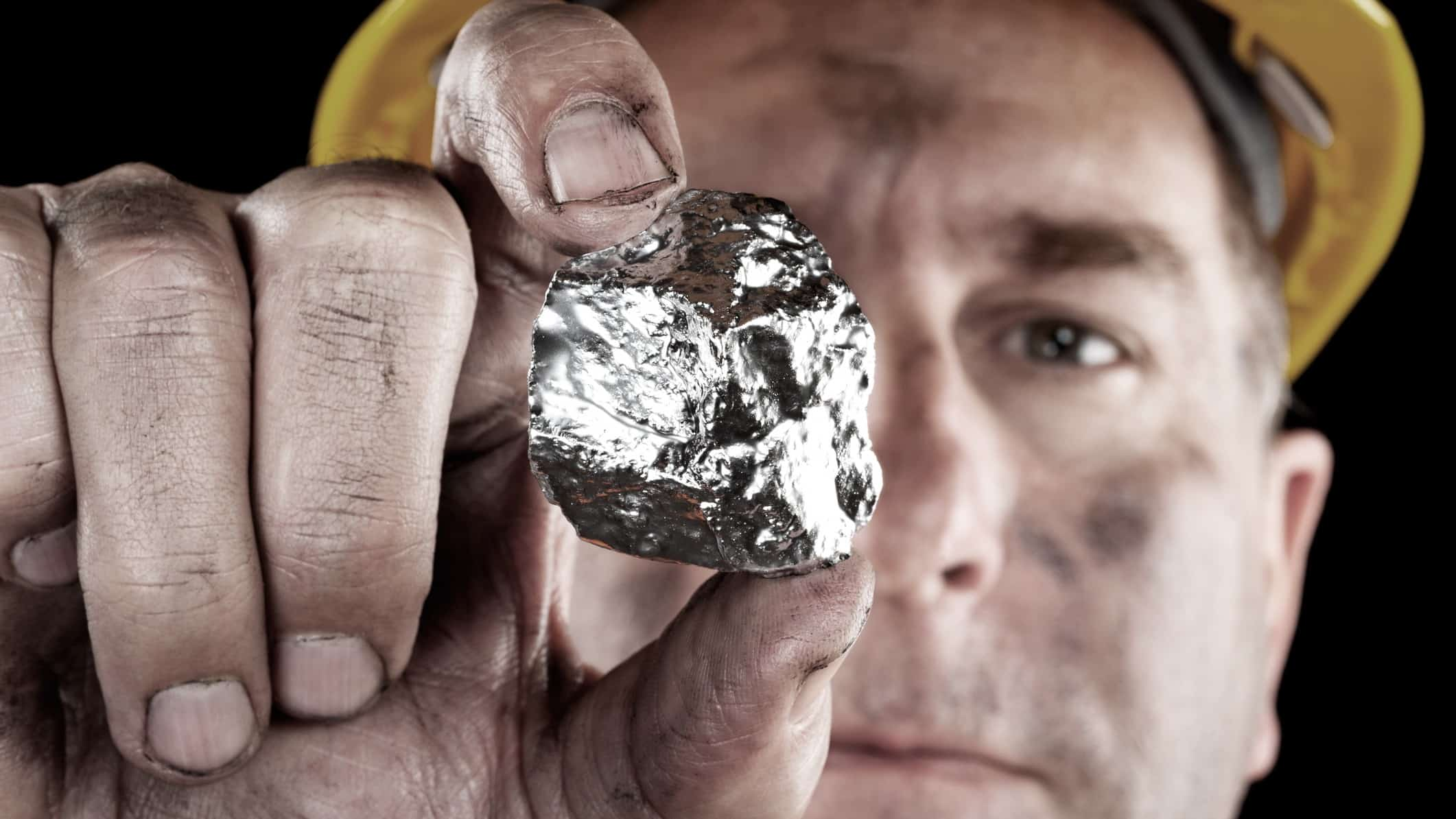Miner holding a silver nugget