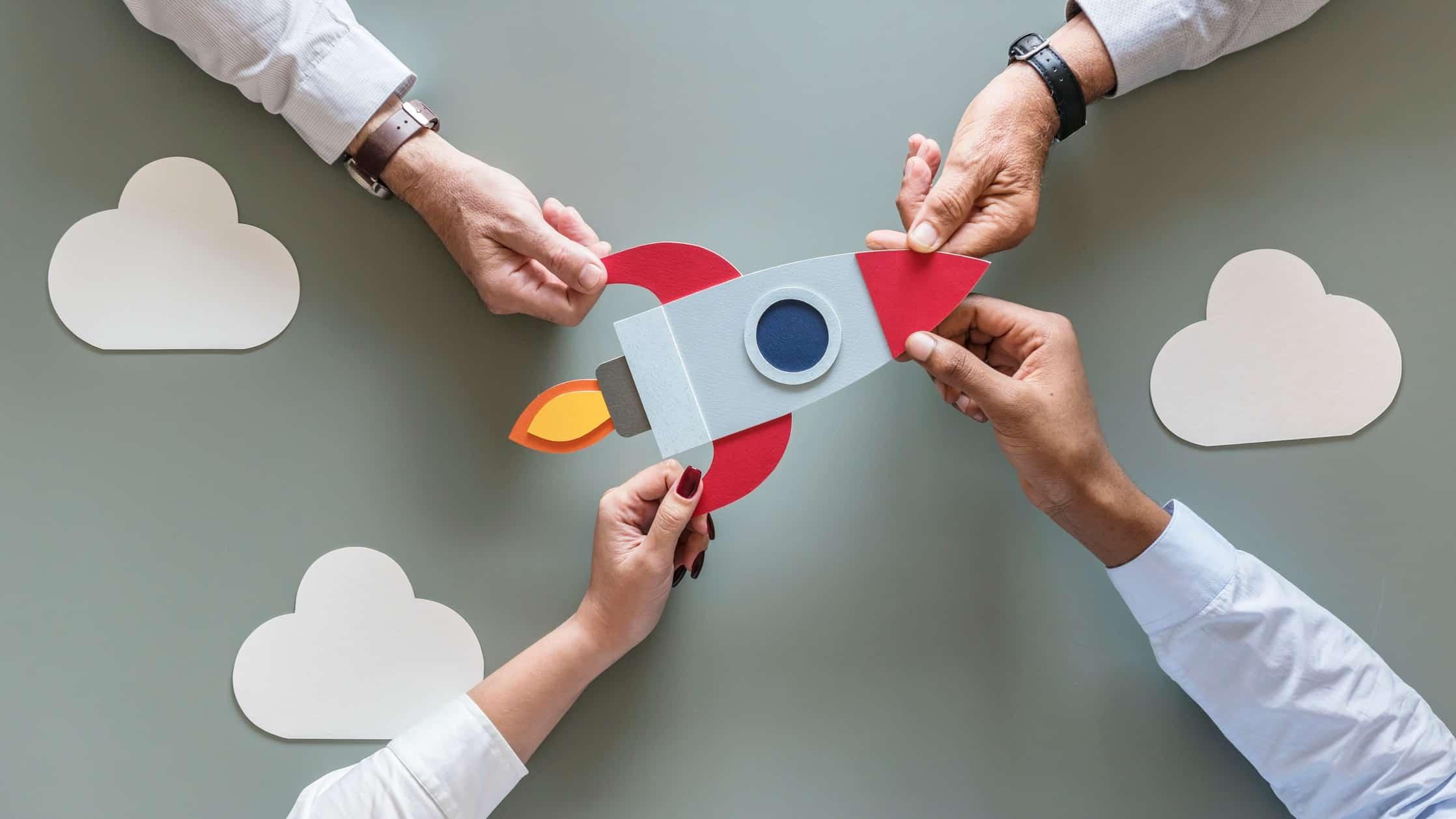 four hand grabbing paper cut out of rocker representing 4 asx tech shares