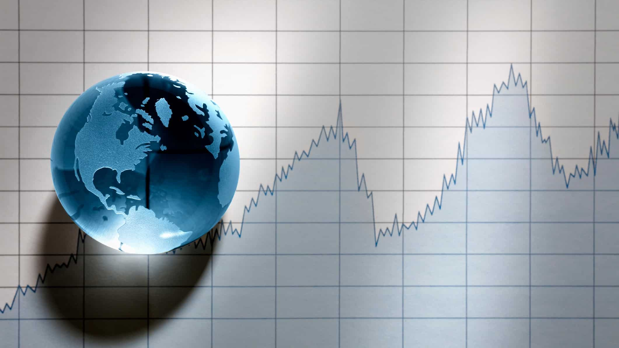 World globe sitting on top of share price chart