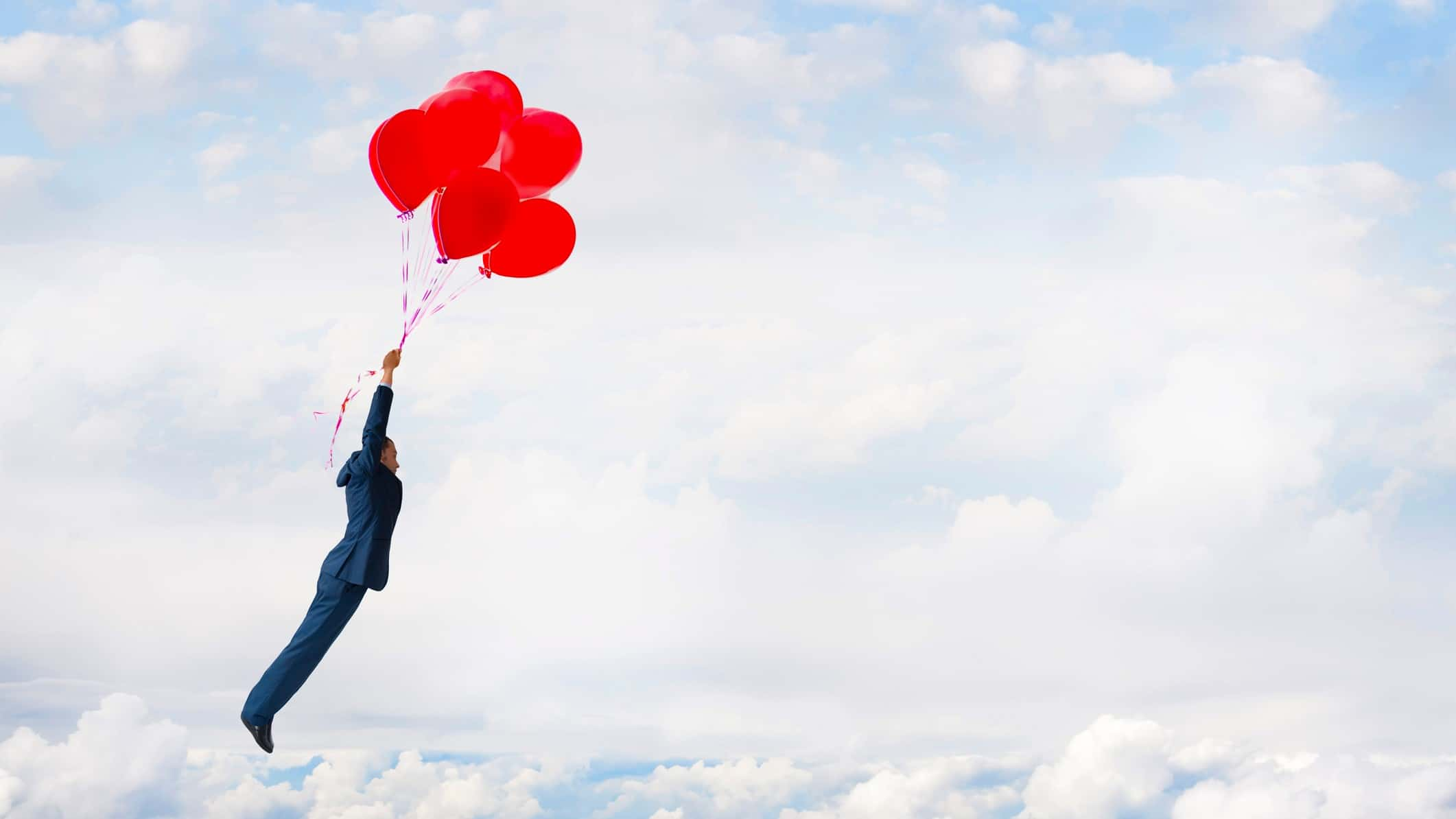 man holding bunch of balloons soaring through the air signifying asx share price rise