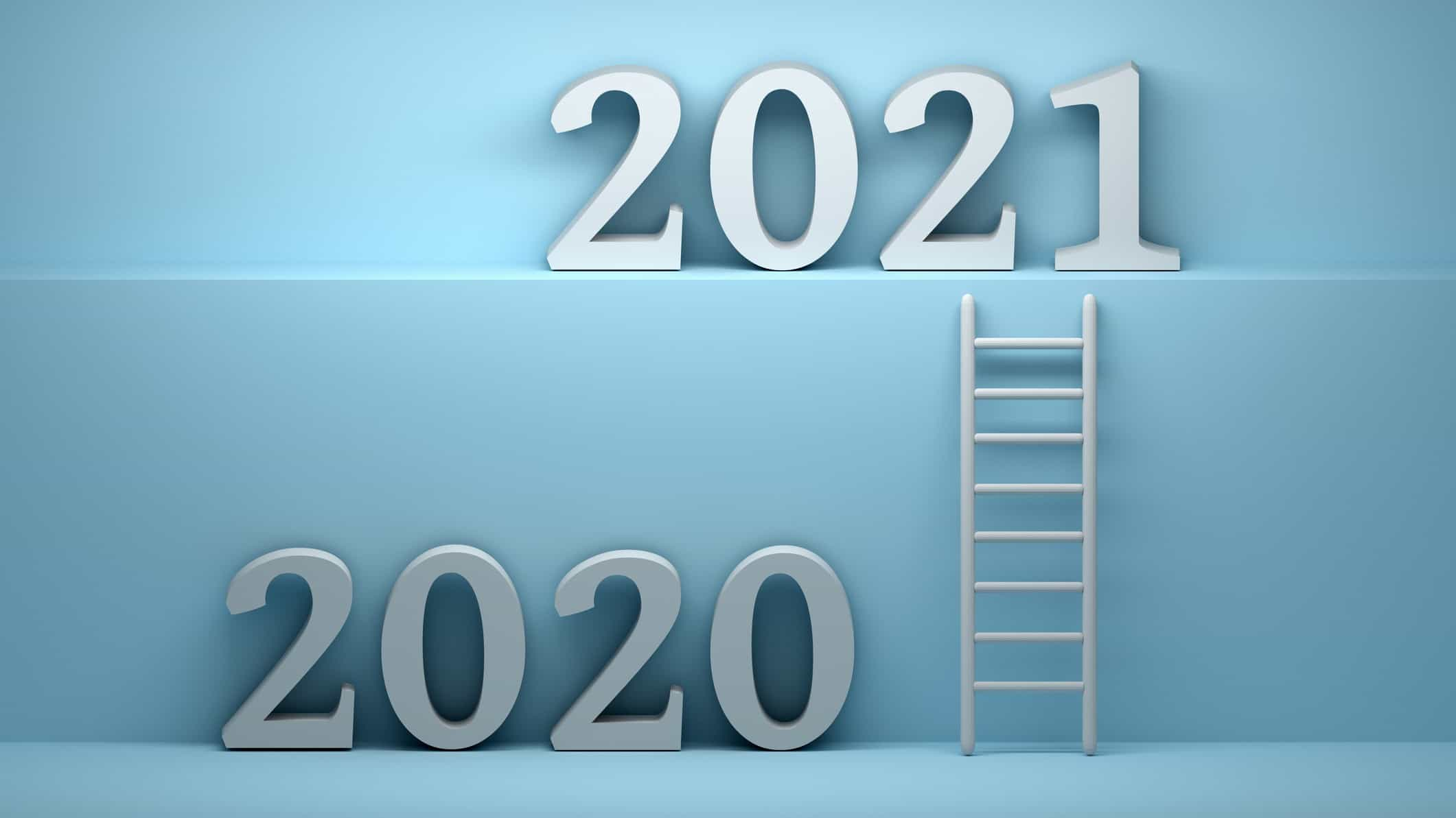 ladder positioned between the numerals 2020 and 2021