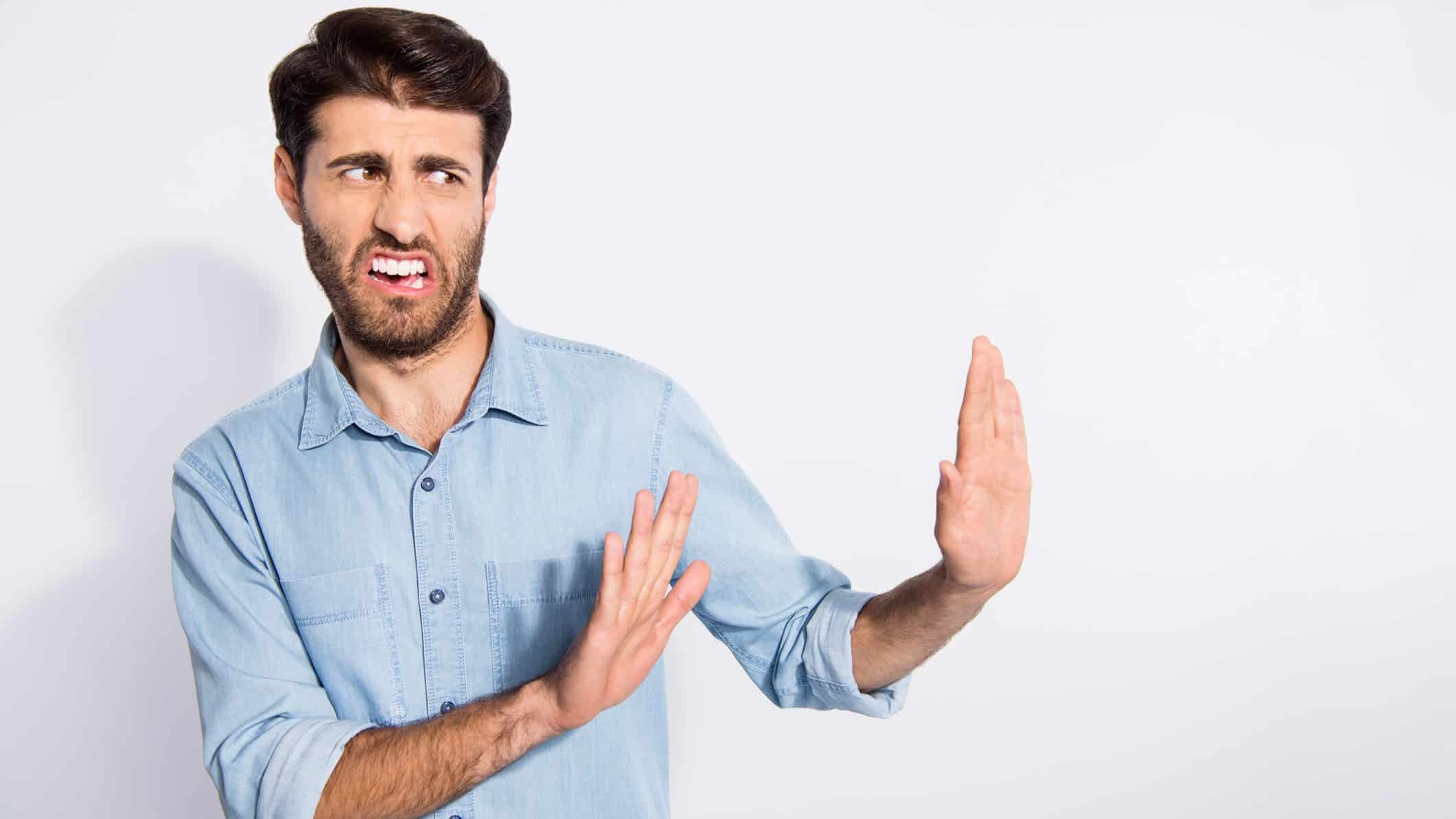 Turning down AGL shares represented by man placing hands up in front of him and frowning
