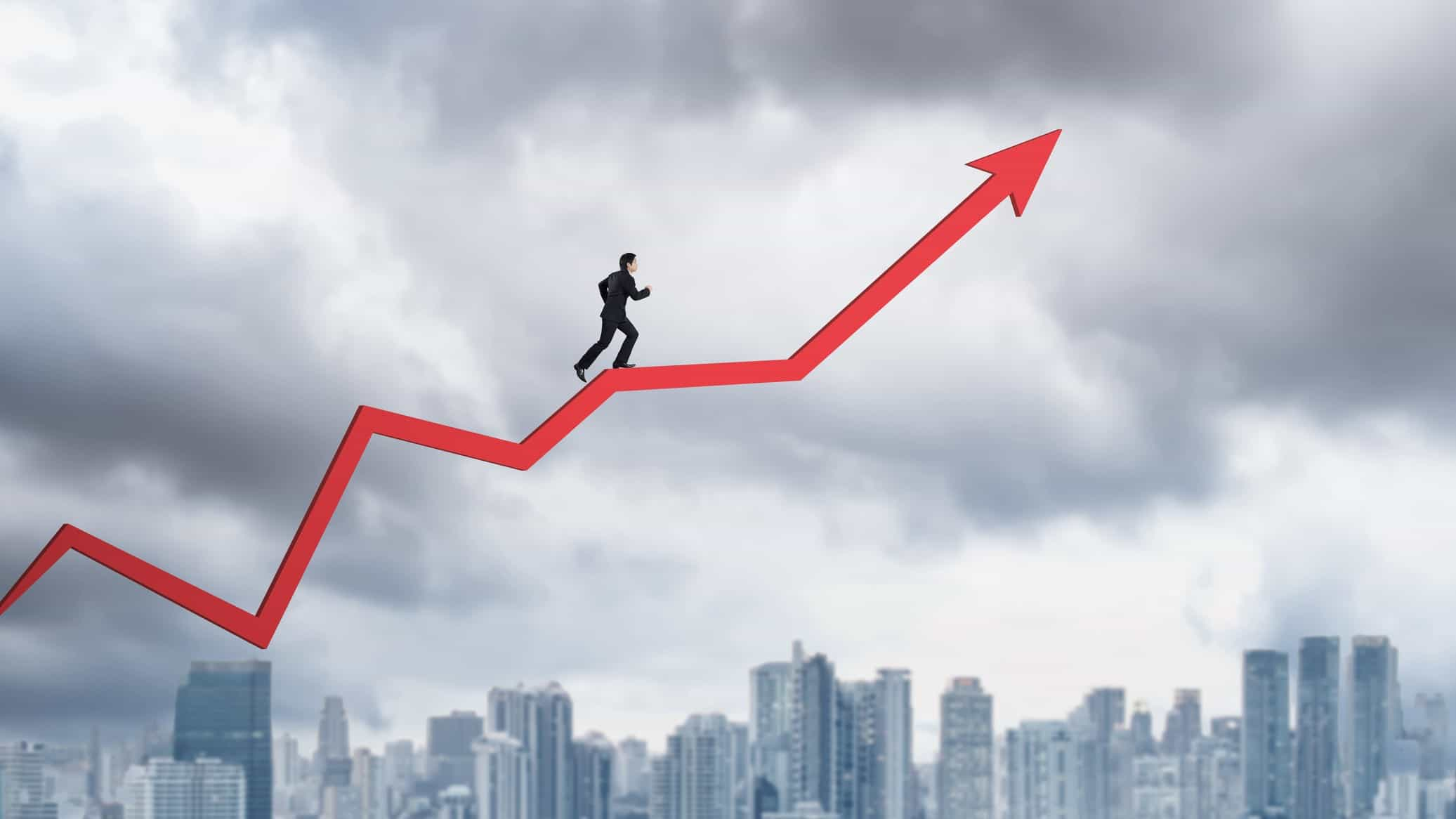 man walking up line graph, into clouds, representing asx shares at an all time high