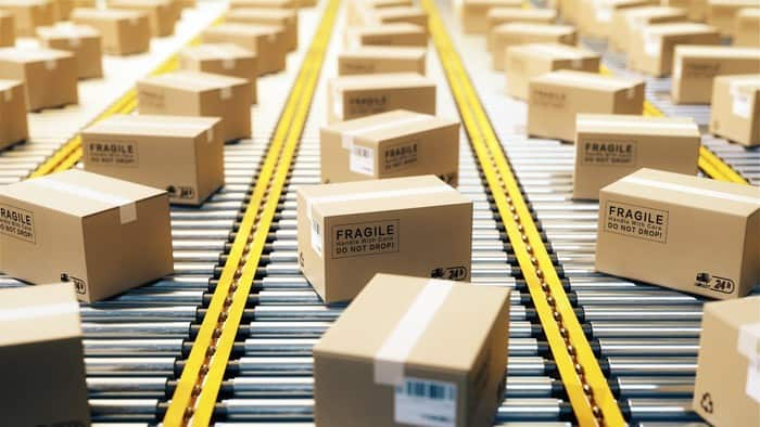 amazon shares represented by lots of boxes on production line ready for shipping