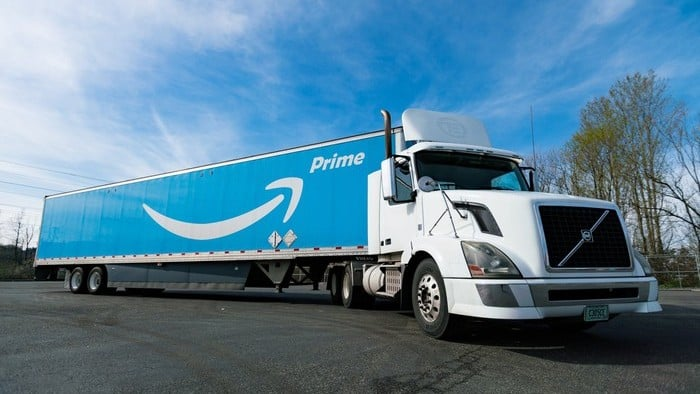 Amazon stock represented by Amazone prime truck driving along