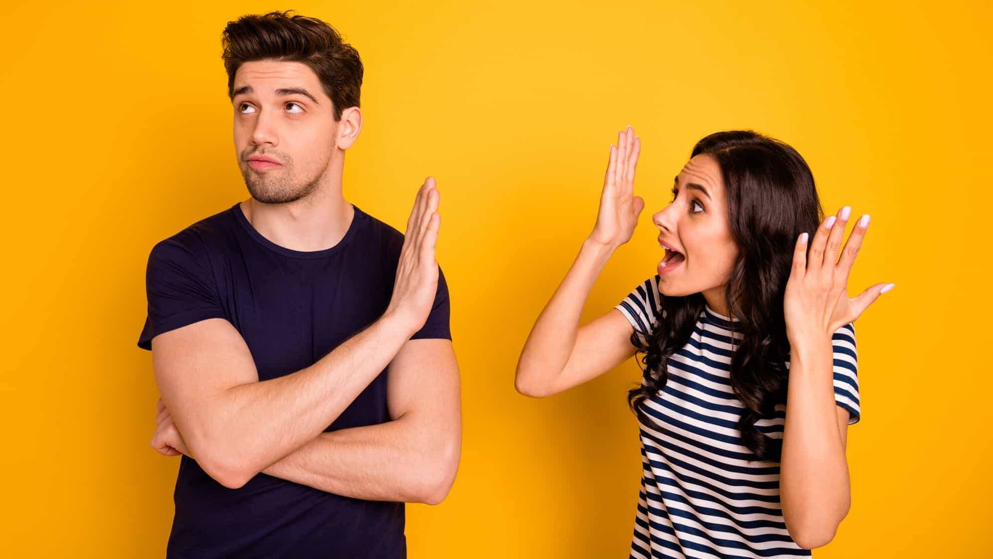 A couple young arguing against a yellow backdrop, indicating a tussle over business decision