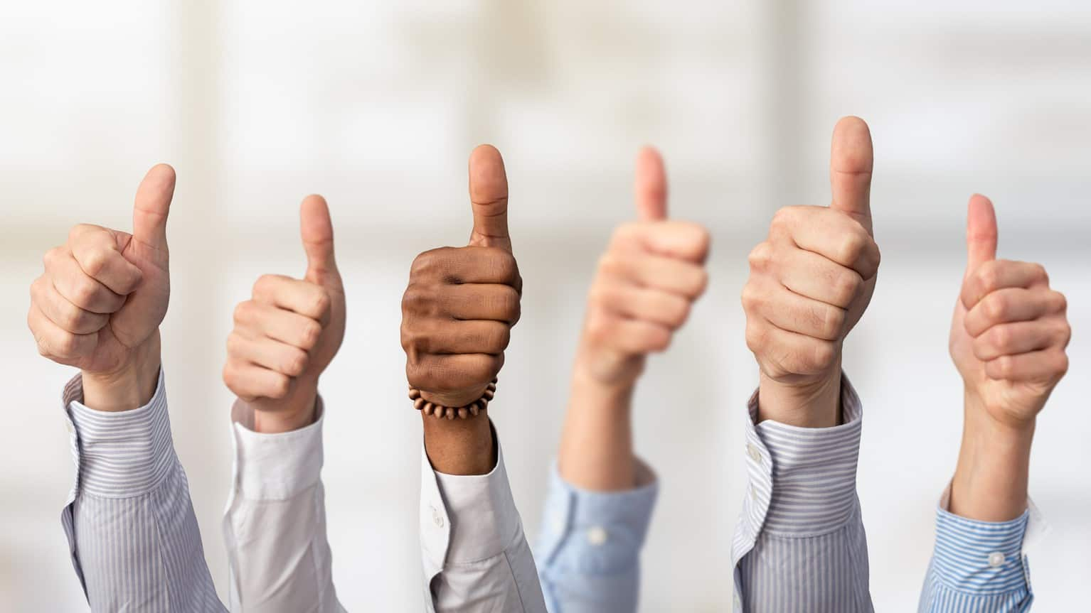 group of hands all giving thumbs up gesture