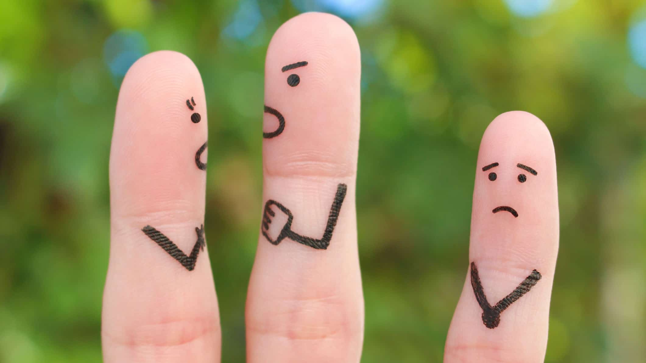 asx 200 shares downgraded represented by three fingers with sad and angry faces
