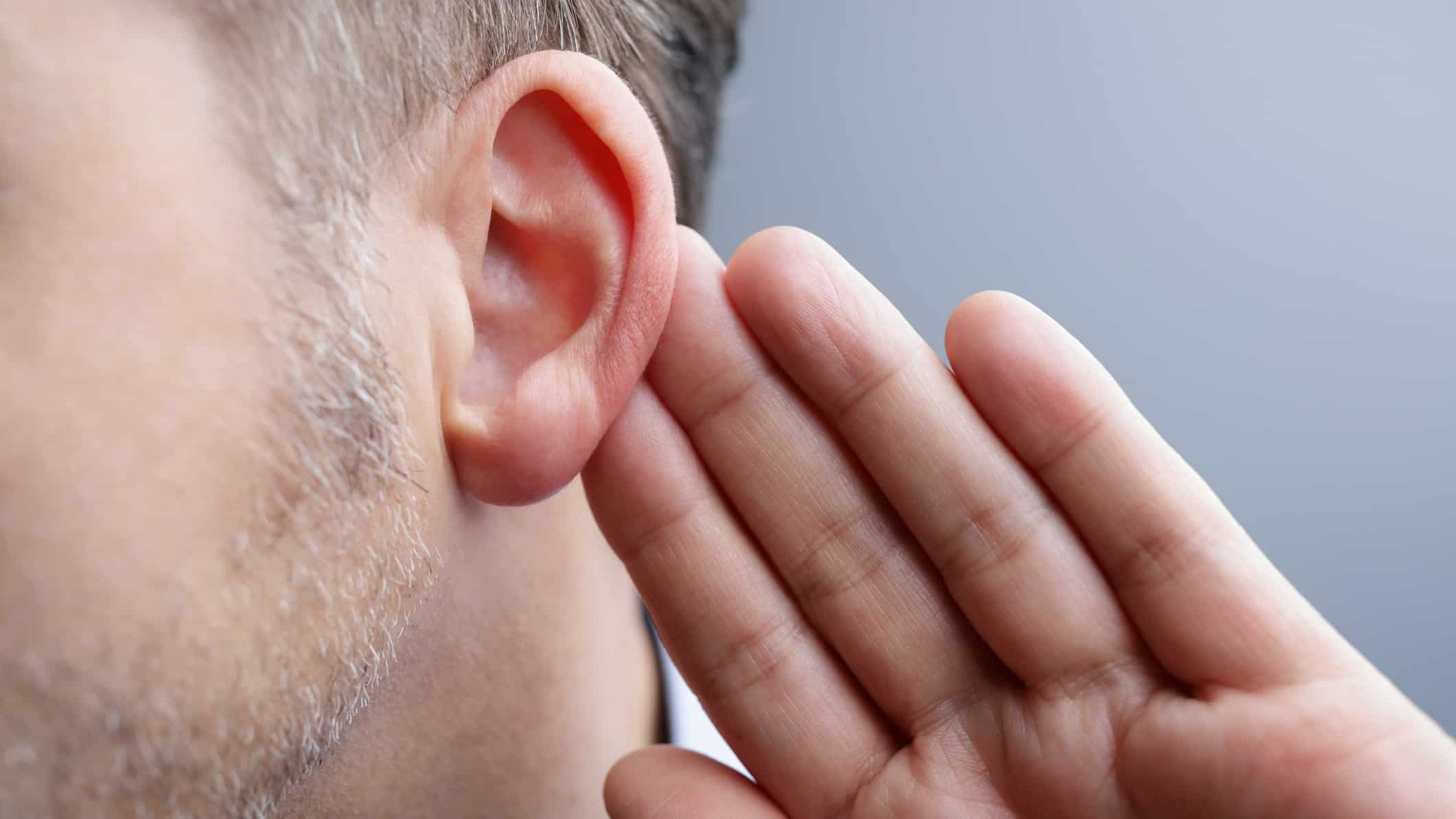 man holding his ear as if listening to what the asx 200 is telling us