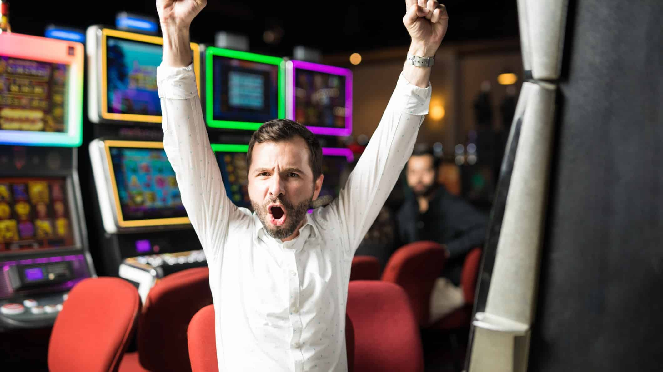 asx gaming share price rice represented by man playing pokies and celebrating a win