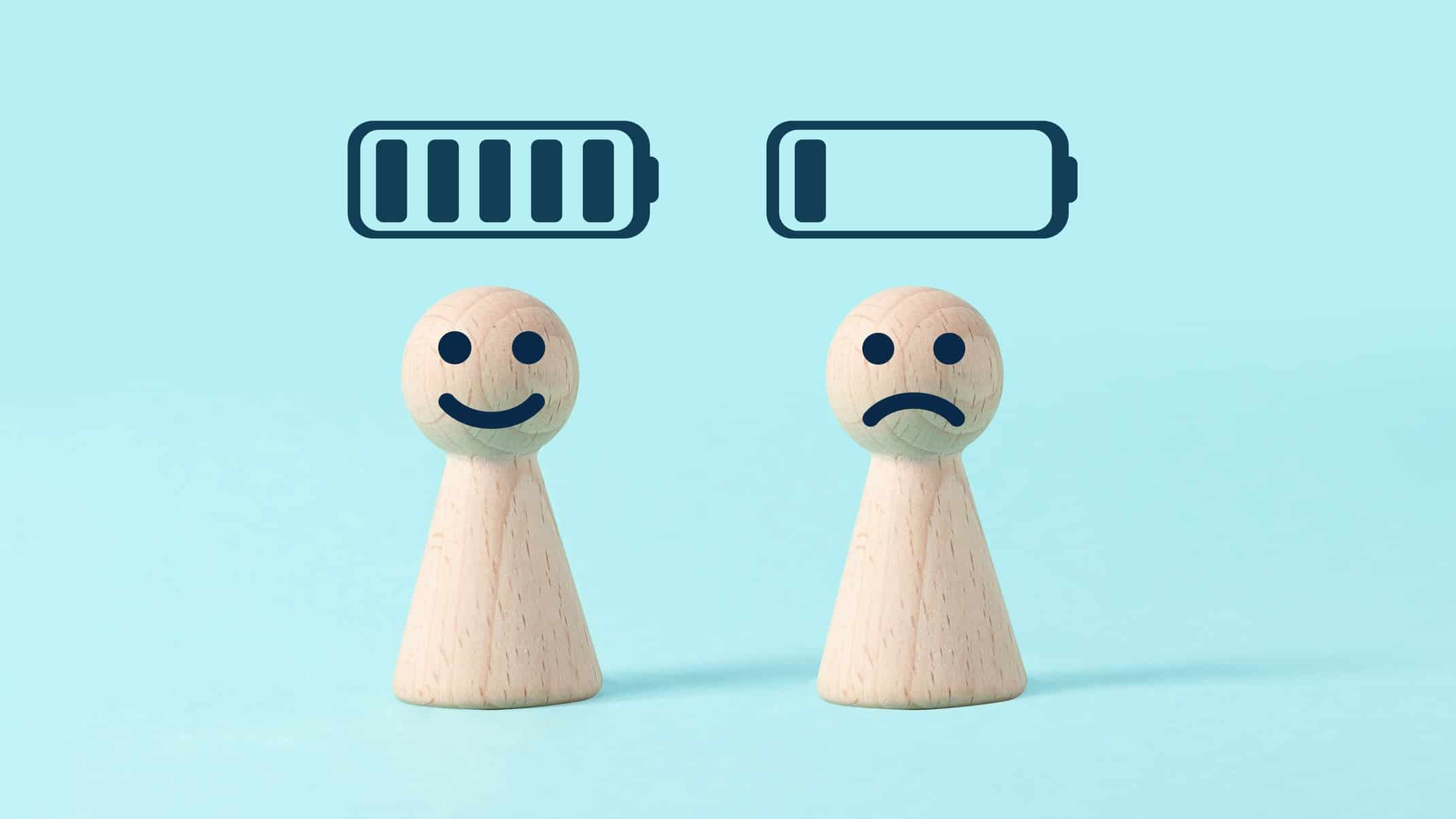 asx lithium shares represented by two little wooden peg dolls one with happy face below full battery icon, the other with sad face below empty battery icon
