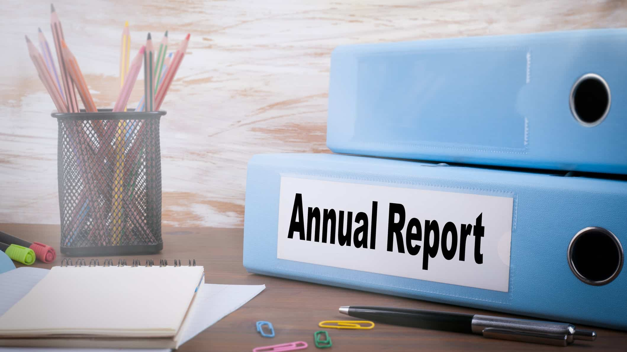 pencils, pen, note pad, paper clips and folder entitled annual report signifying asx reporting season