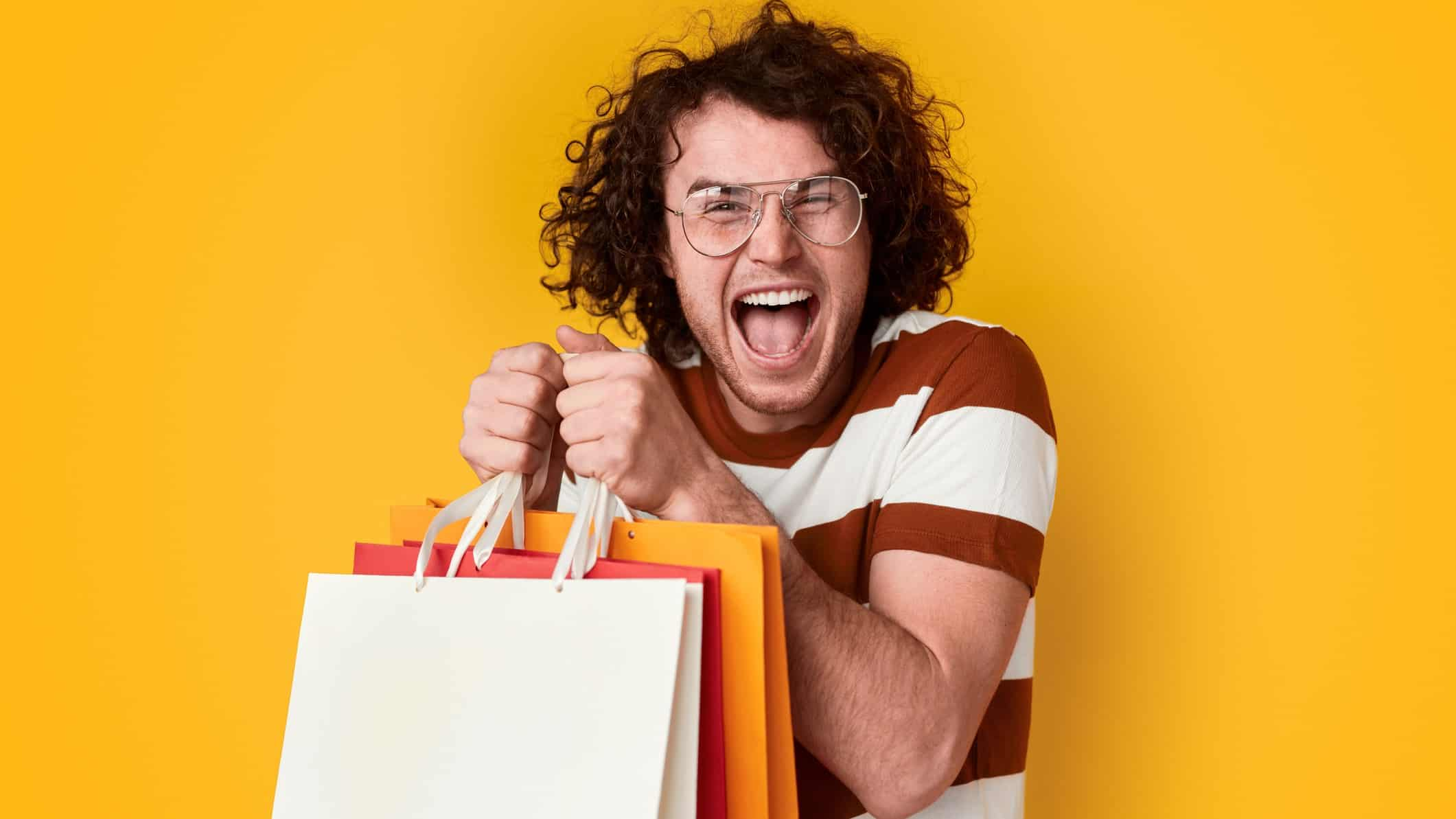 rising retail asx share price represented by excited shopper holding lots of bags best buy