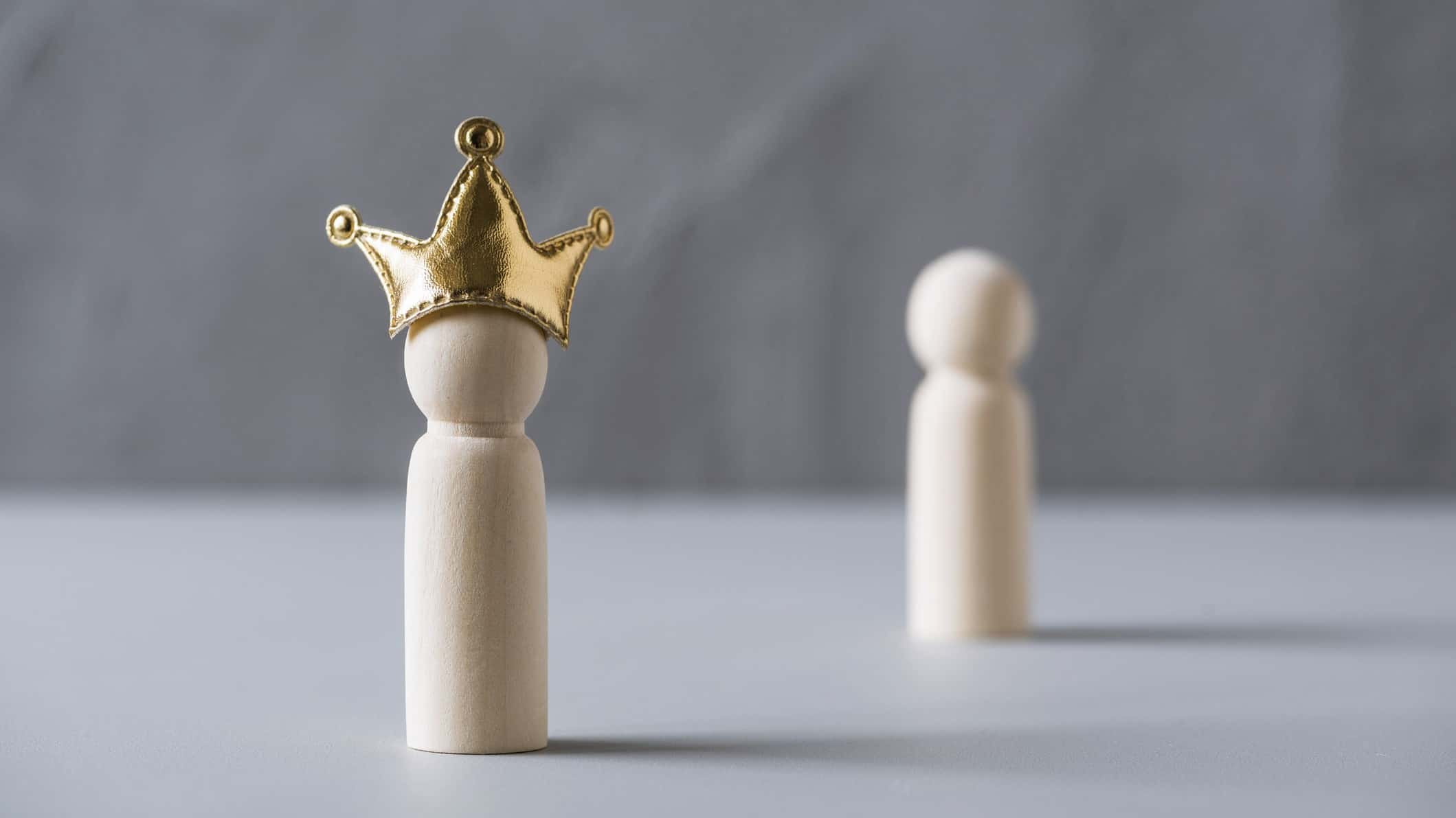 asx shares management represented by wooden peg doll wearing gold crown