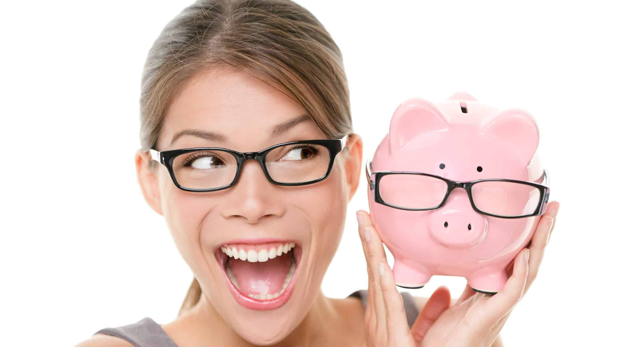 rising asx share price represented by smiling woman holding piggy bank