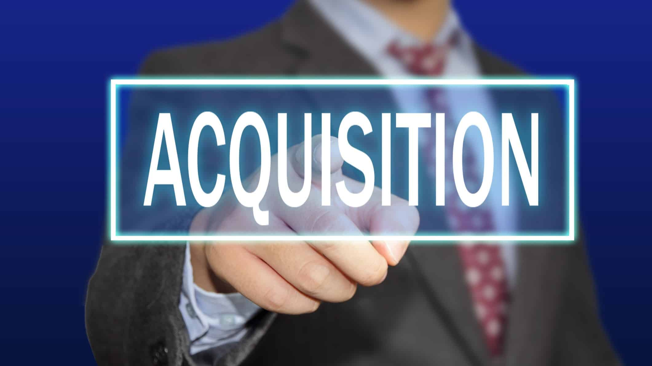 changing asx share price from acqusition represented by man reaching out to touch acquisition sign