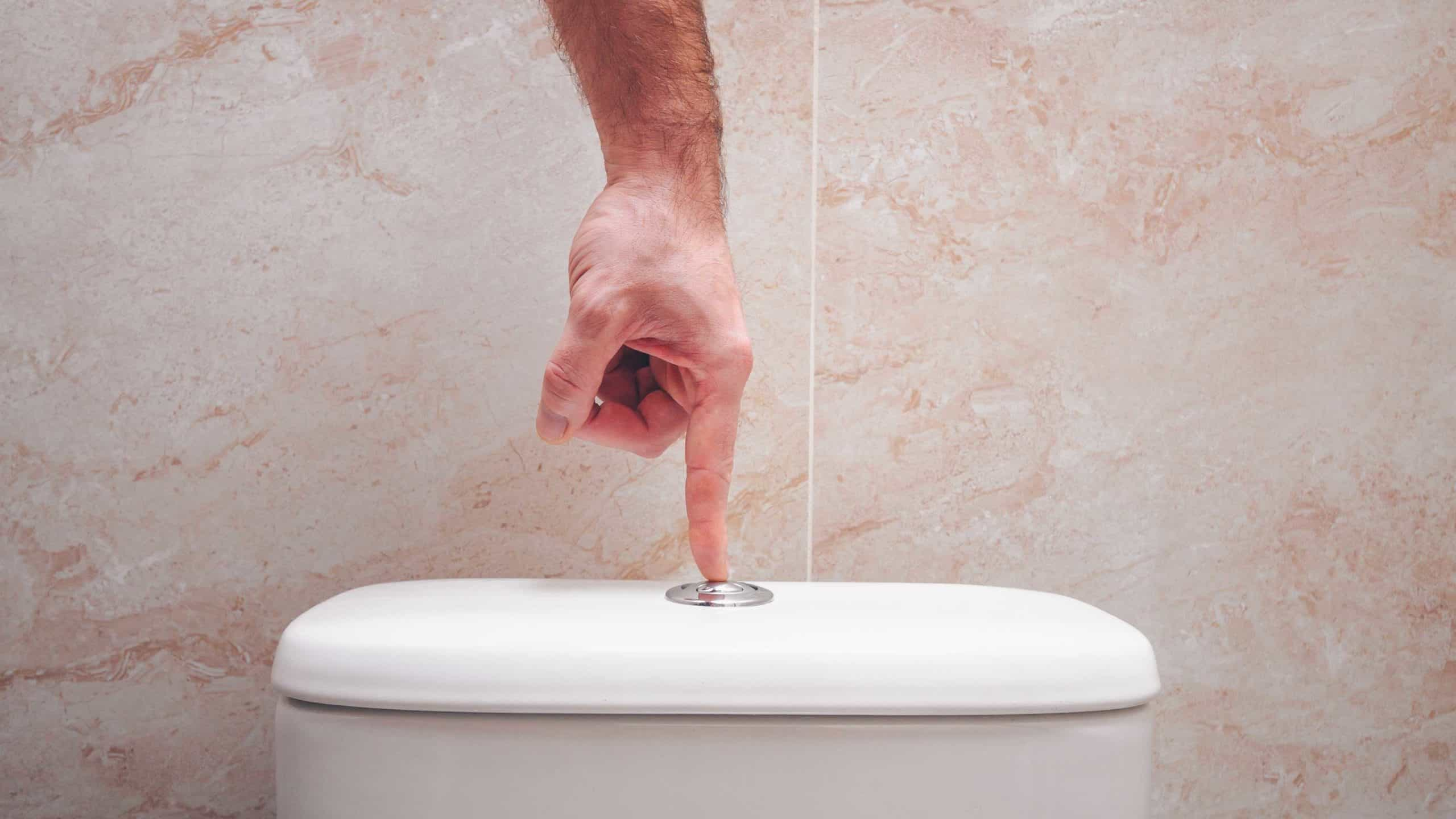 sinking asx share price represented by hand pushing flush button on toilet