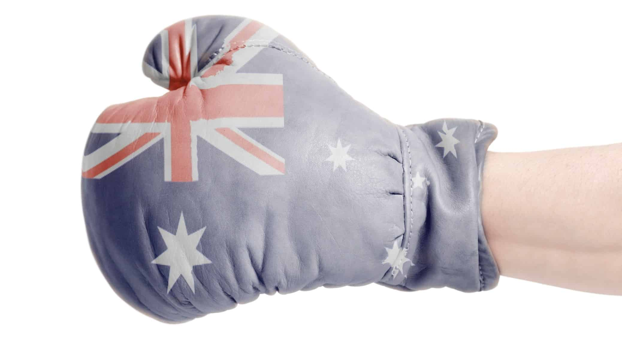 Upgrade of asx shares represented by boxing glove printed with australian flag