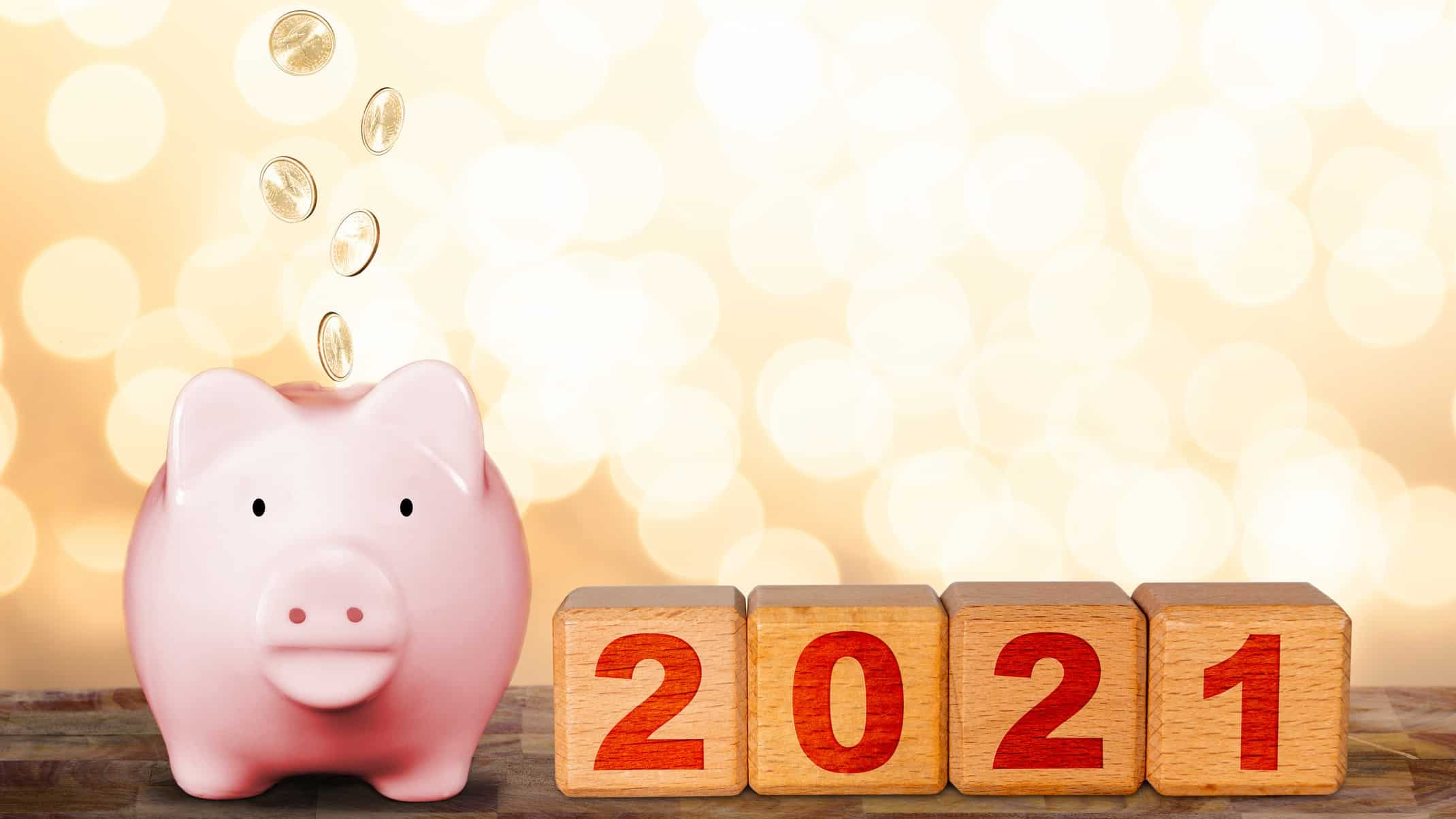 mineral resources top ascx shares to buy in 2021 represented by piggy bank sitting alongside wooden blocks saying 2021