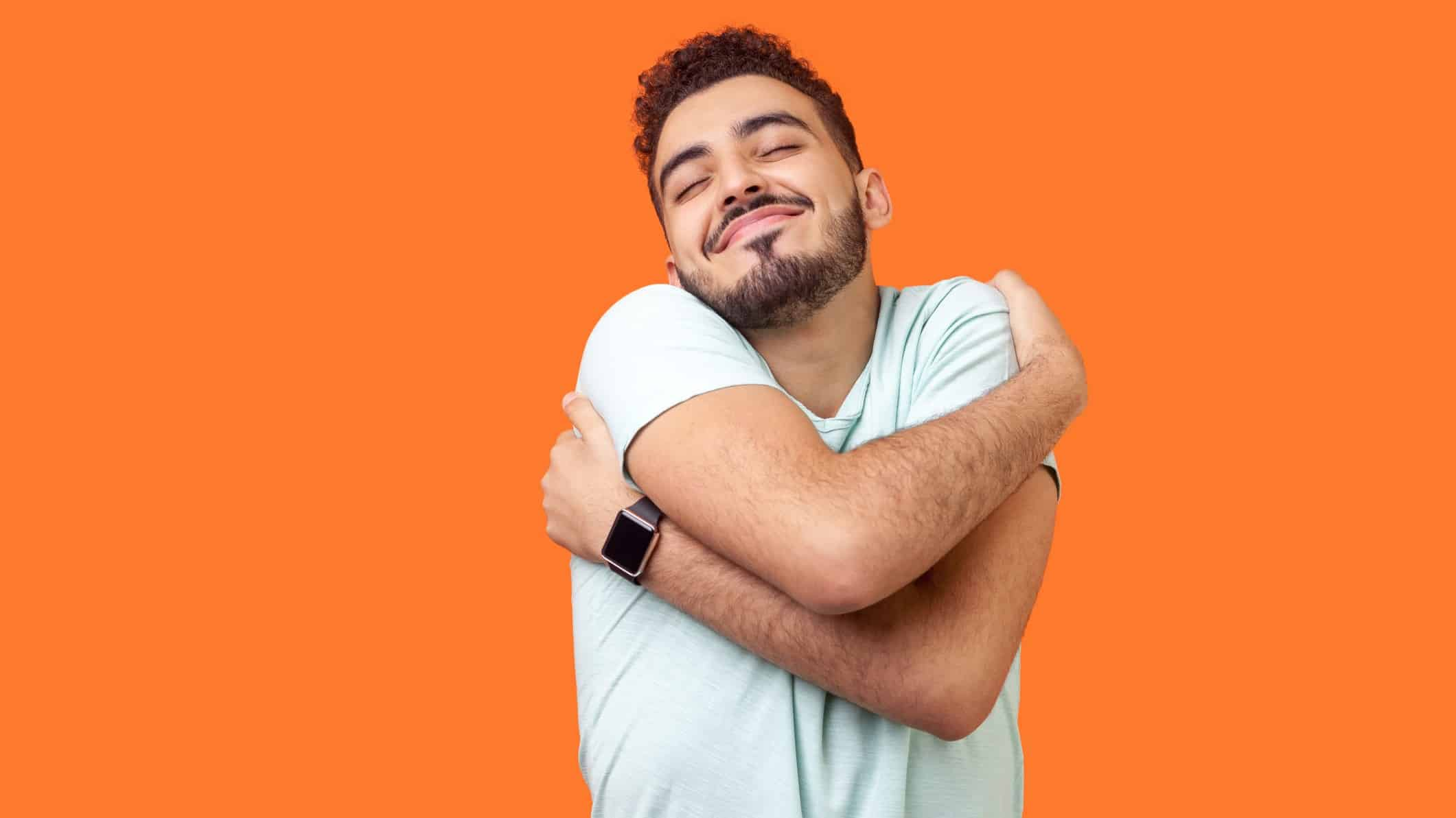 asx shares to buy and hold represented by man happily hugging himself