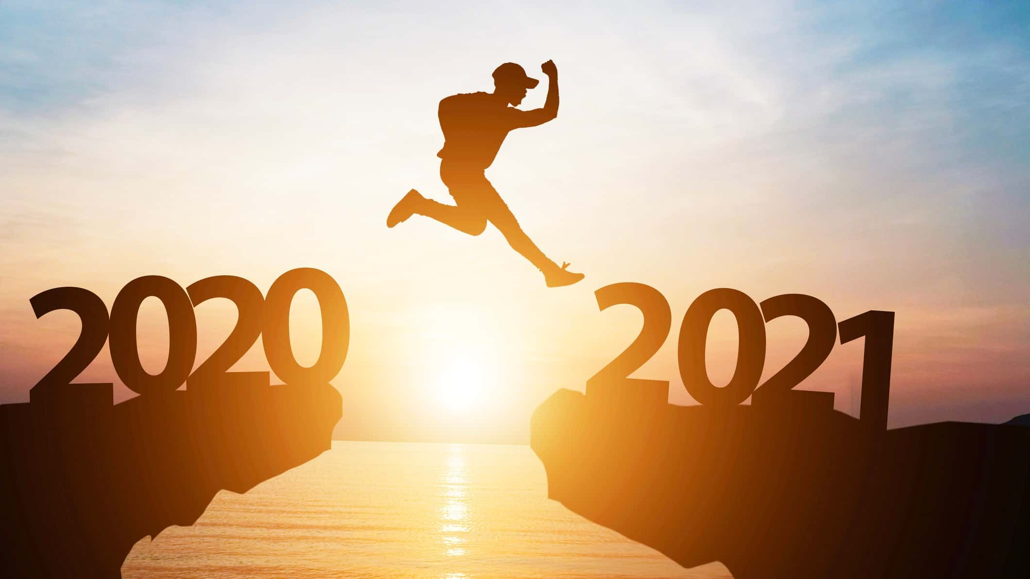 man jumping from 2020 cliff to 2021 cliff representing asx outlook 2021