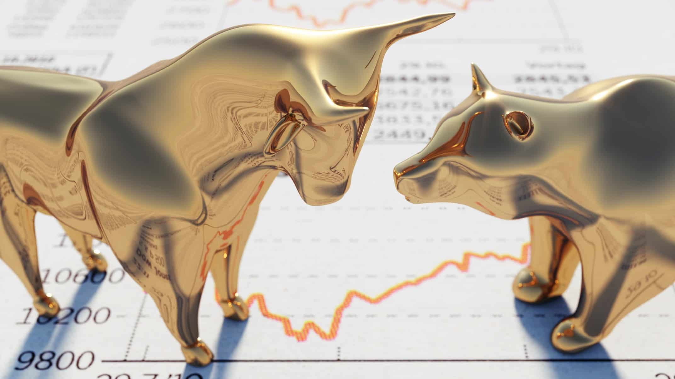 gold bull figurine standing on stock price charts representing rising asx share price