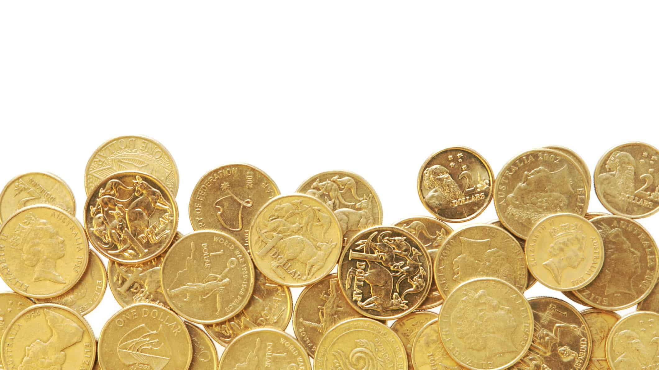 bargain stocks represented by one and two dollars coins in a pile