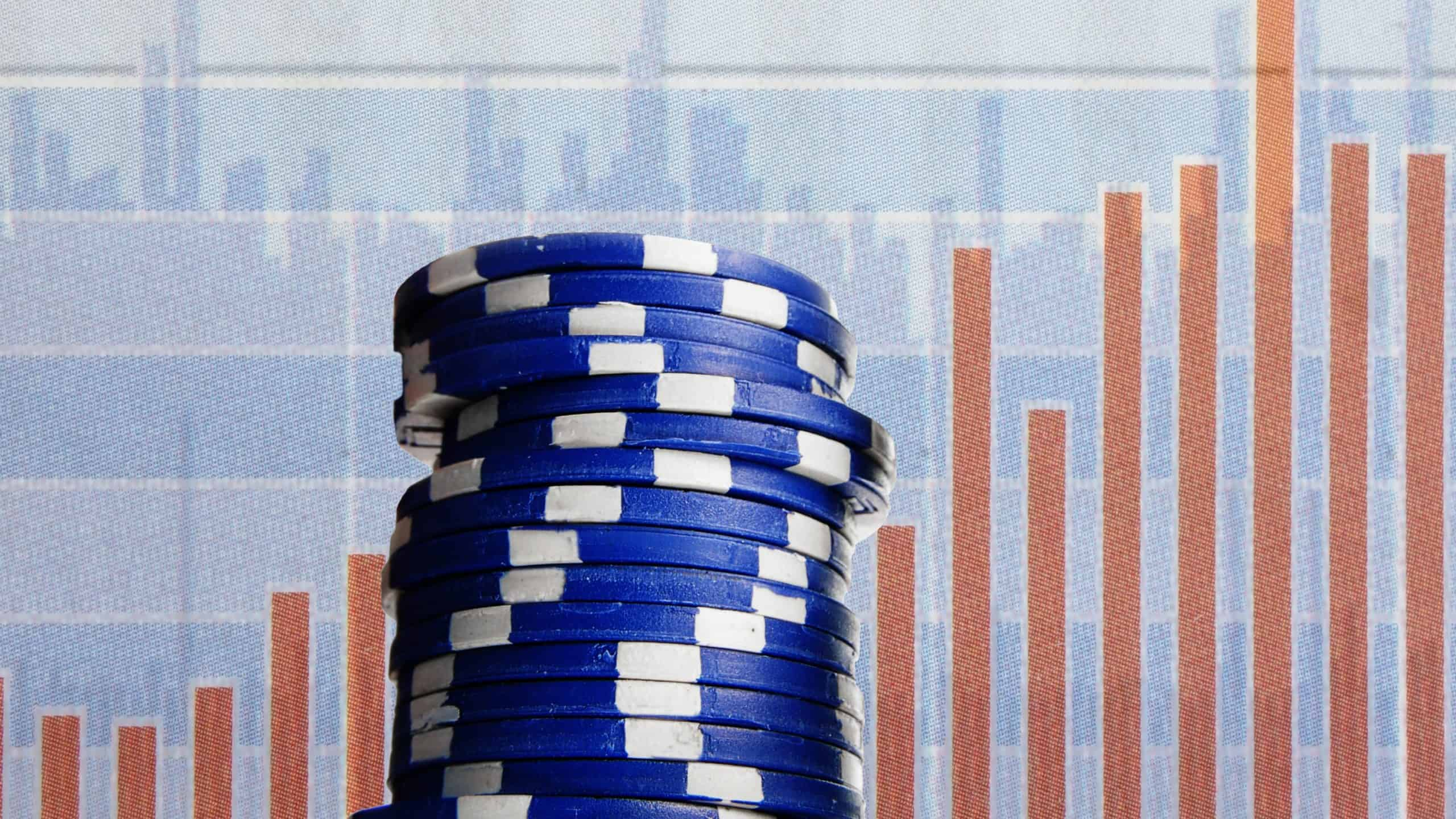 Pile of blue casino chips in front of bar graph, asx 200 shares, blue chip shares