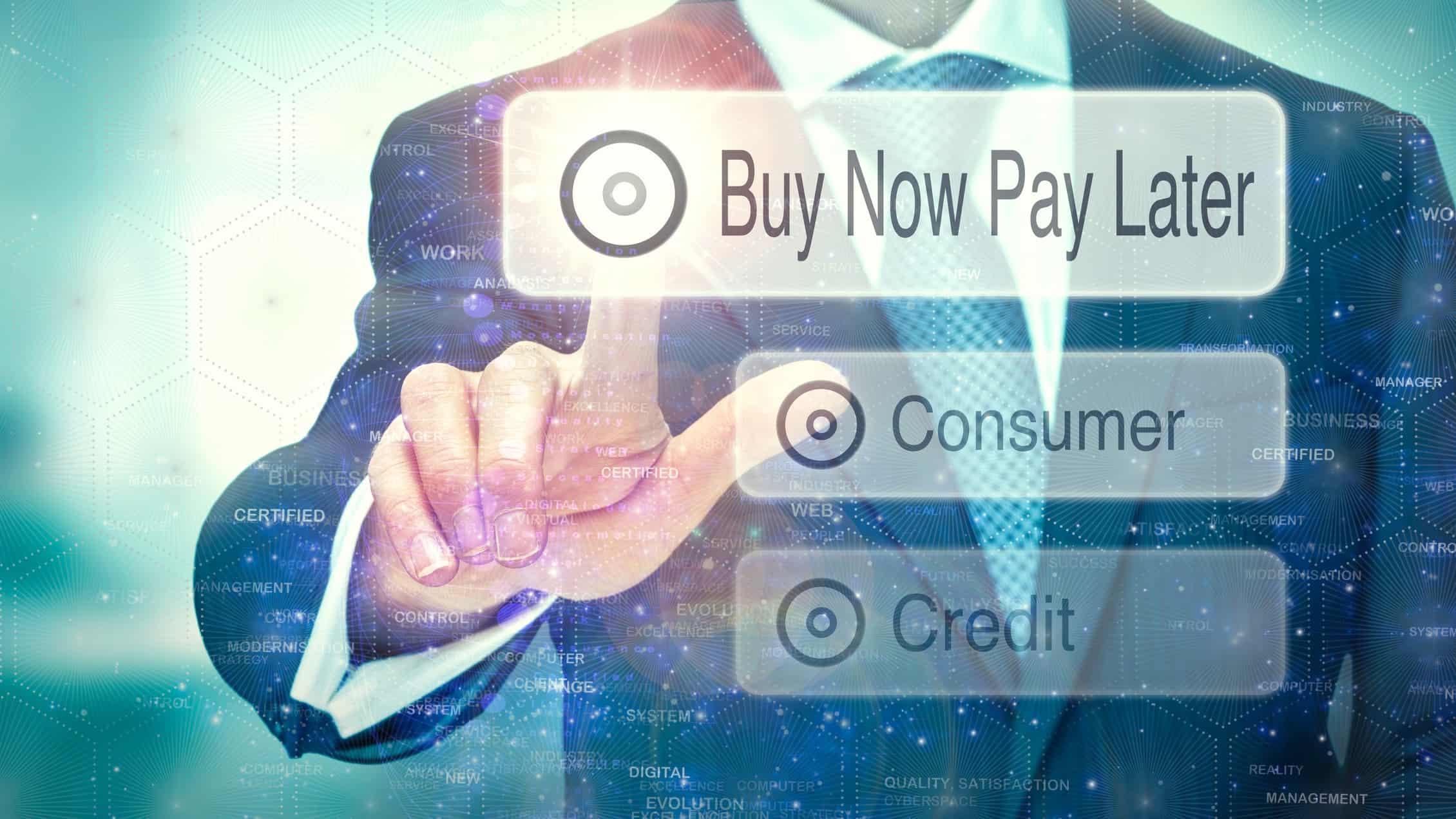 man hitting digital screen saying buy now pay later