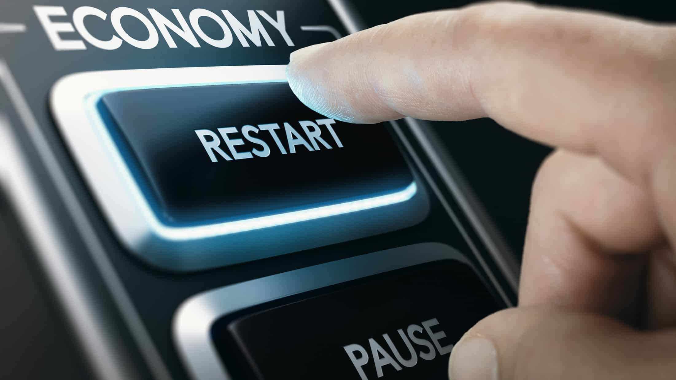 asx shares and the economy represented by finger pressing restart on a device titled economy