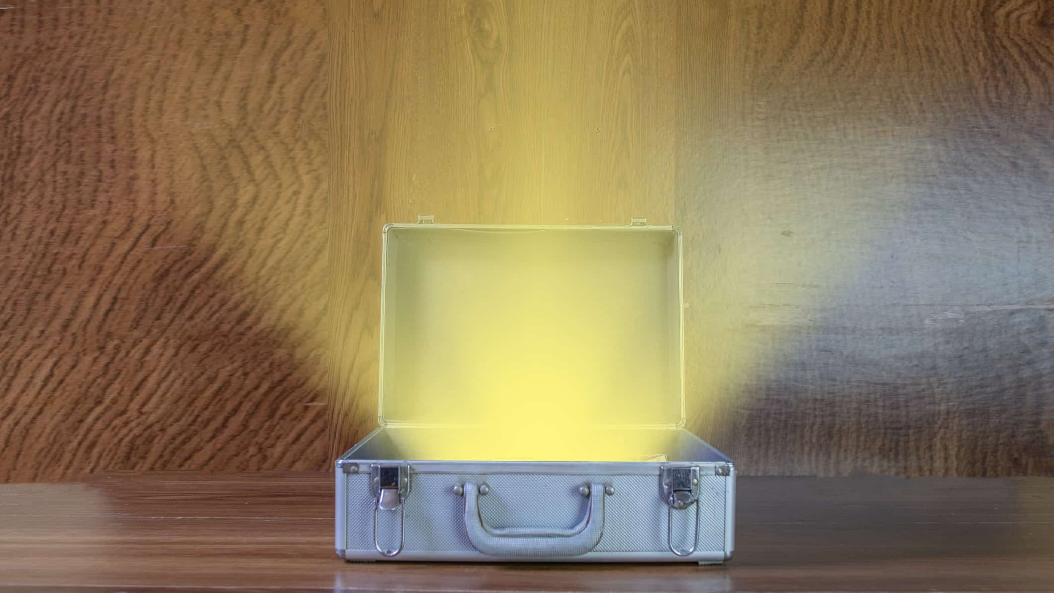 cheap stocks represented by open brief case with golden light shining from it