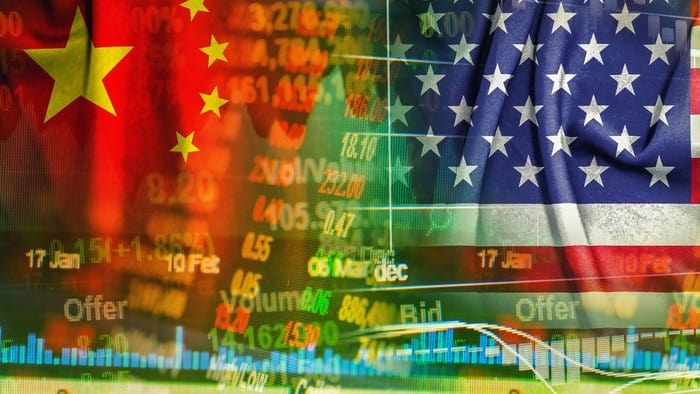 US and Chinese stocks charts against backdrops of national flags