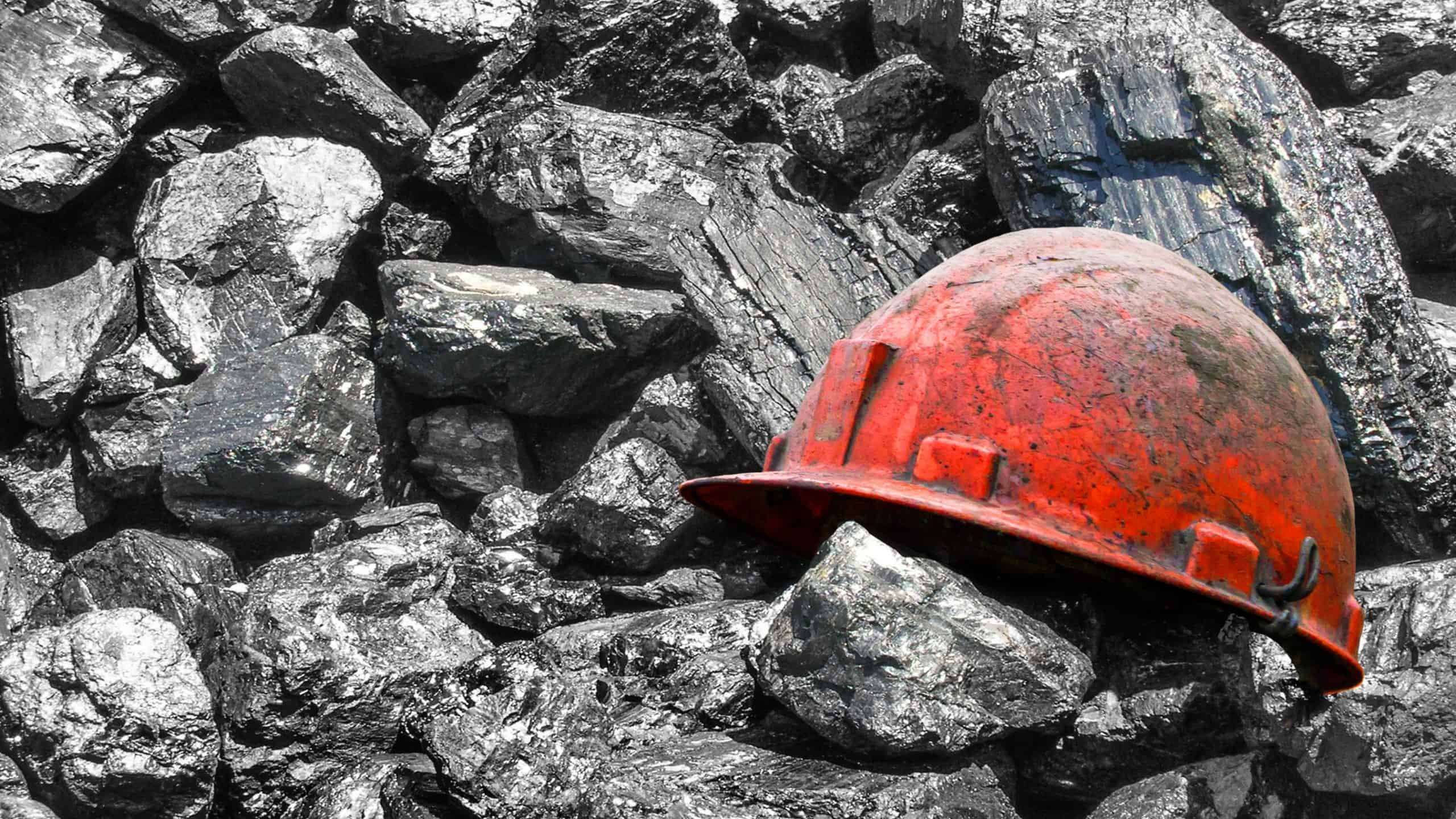 miner's hard hat on pile of coal MGA Thermal ASX coal stocks