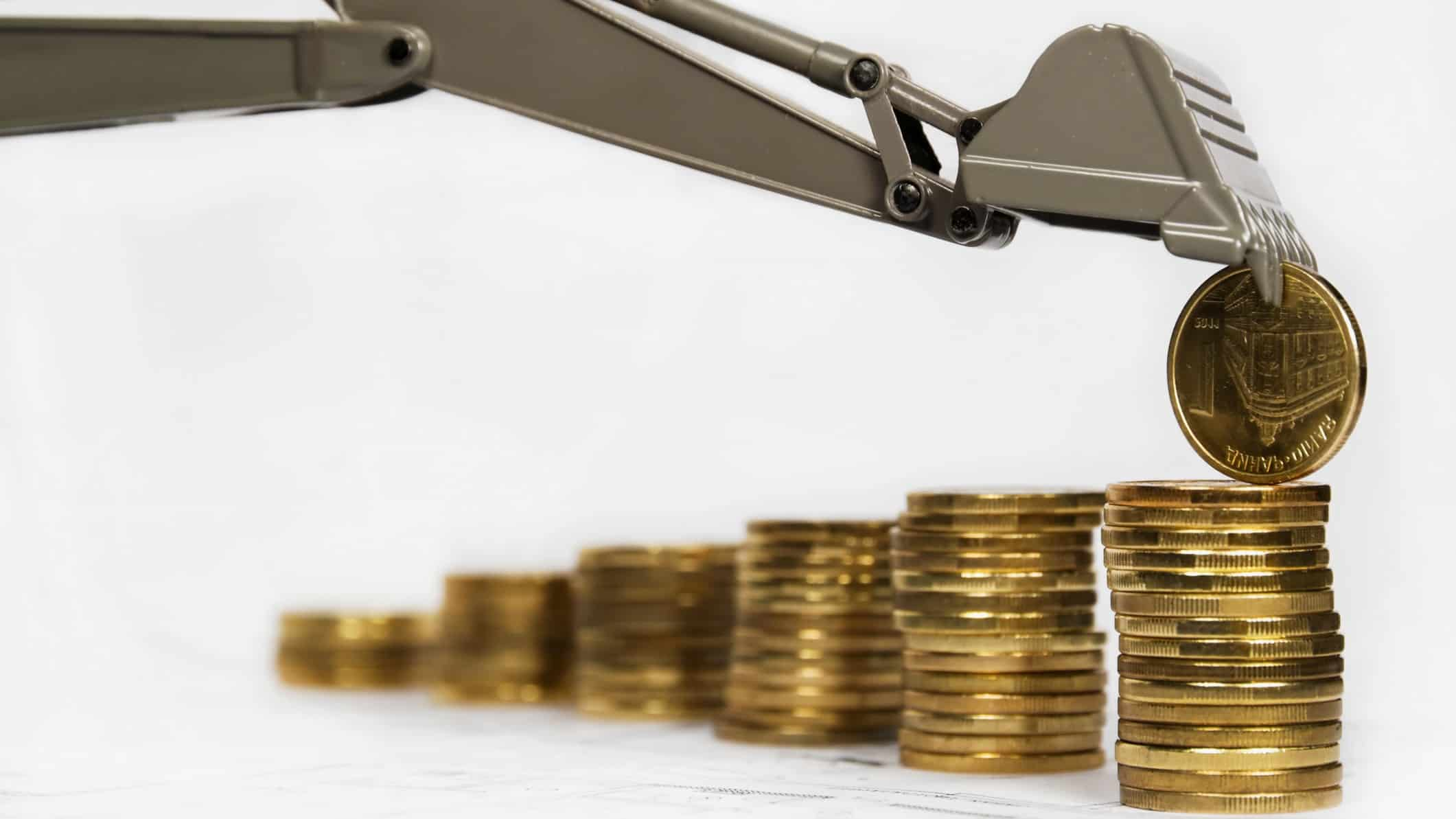 digger placing coin on growing pile of coins, boral share price