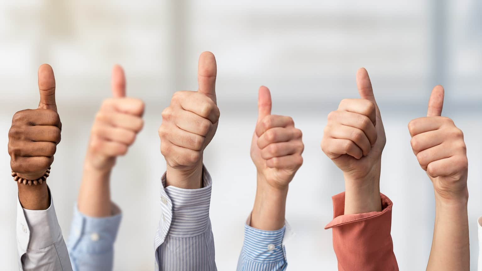 lots of hands all making thumbs up gesture